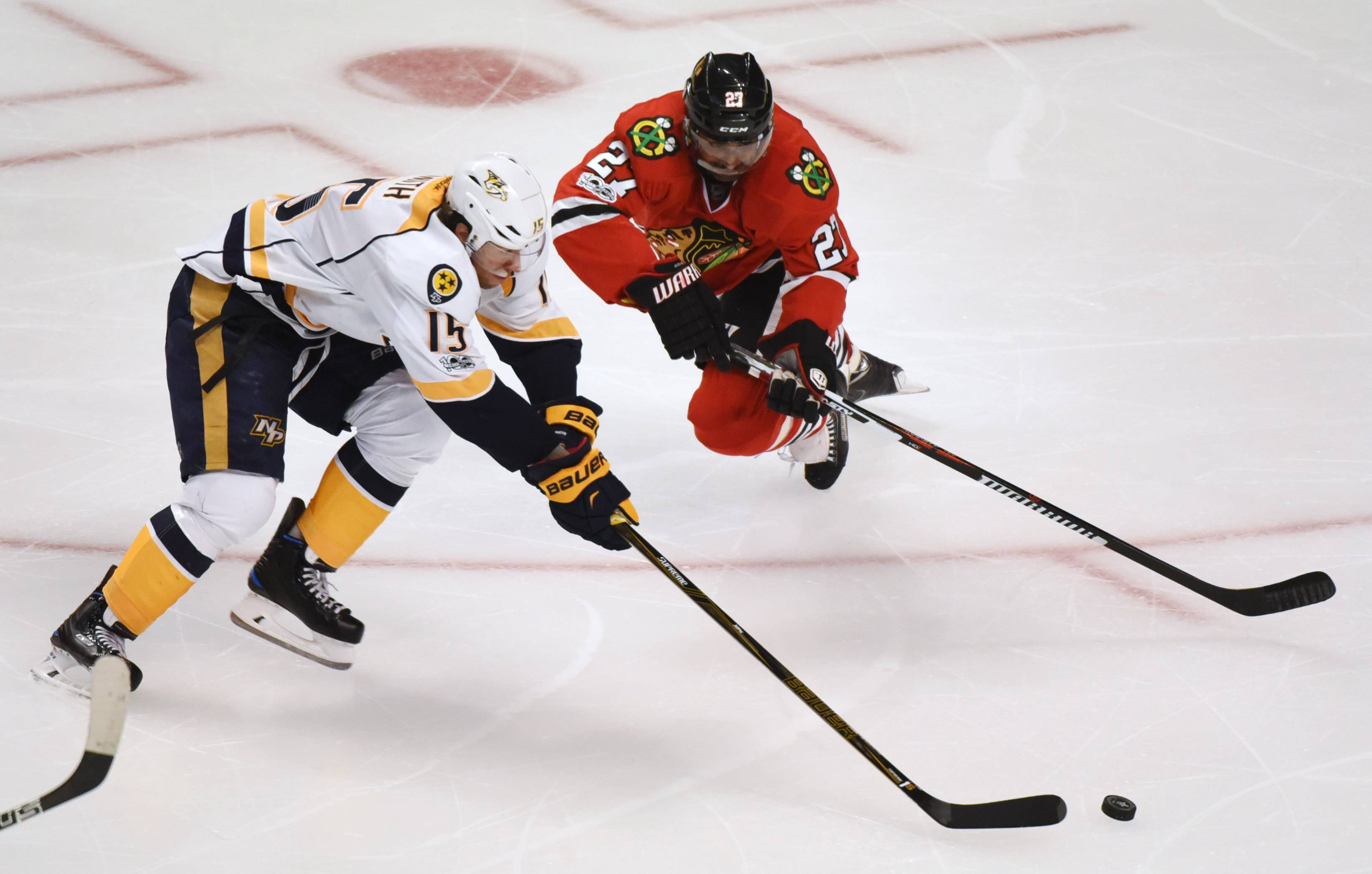 Blackhawks defenseman Johnny Oduya, right, lunges toward the puck as Nashville Predators center Craig Smith closes in during the third period of the Blackhawks' 1-0 loss in Game 1 of the playoffs. After a first-round drubbing by the Preds, there's no way the Hawks could come back with Duncan Keith, Brent Seabrook, Hjalmarsson, Oduya, Brian Campbell and Trevor van Riemsdyk.