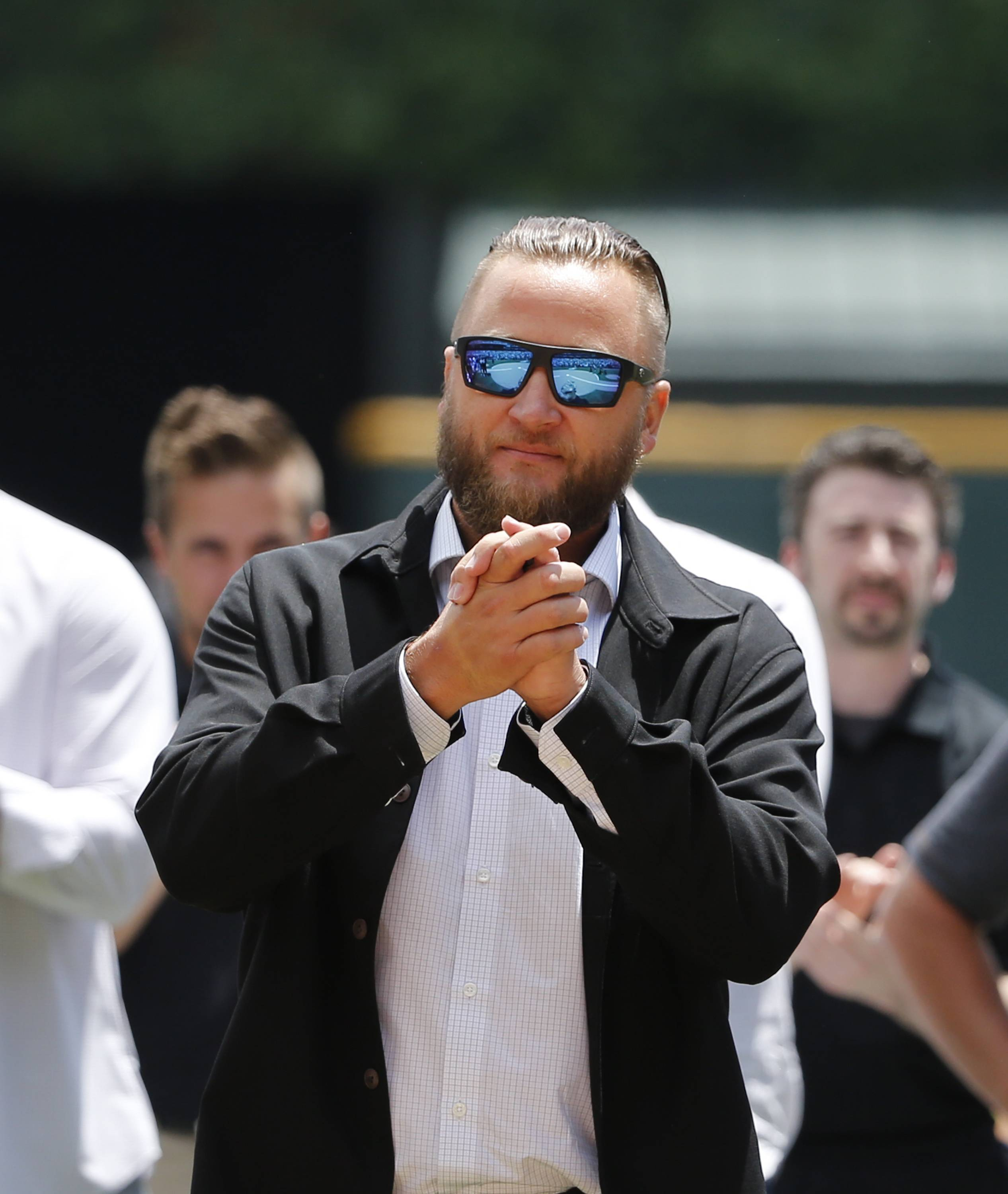 Former Chicago White Sox pitcher Mark Buehrle acknowledges the crowd during ceremonies retiring his No. 56 before a baseball game between the White Sox and the Oakland Athletics Saturday, June 24, 2017, in Chicago. (AP Photo/Charles Rex Arbogast)