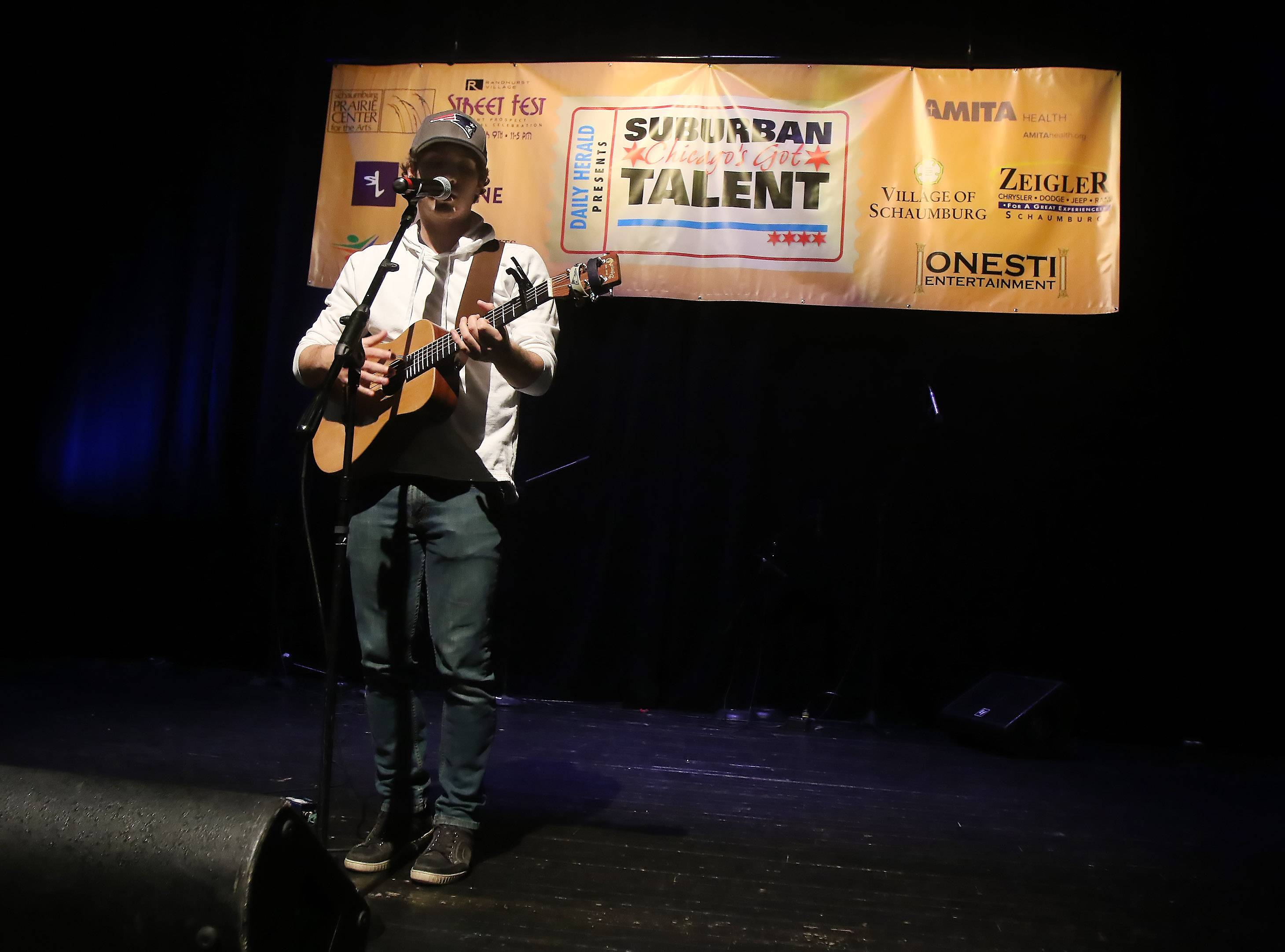 Garrett Ryan of West Dundee sings during Suburban Chicago's Got Talent competition on Sunday at the Prairie Center for the Arts in Schaumburg.