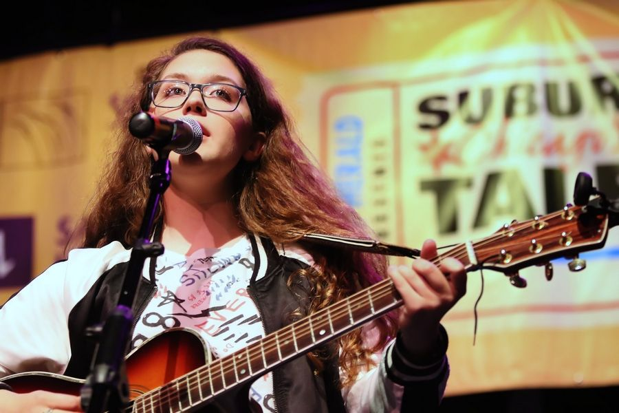 Kayla Seeber of Poplar Grove sings during Suburban Chicago's Got Talent competition on Sunday. The top 20 finalists competed in hopes of winning a grand prize that includes the opportunity to open for a national act at the Arcada Theatre in St. Charles.