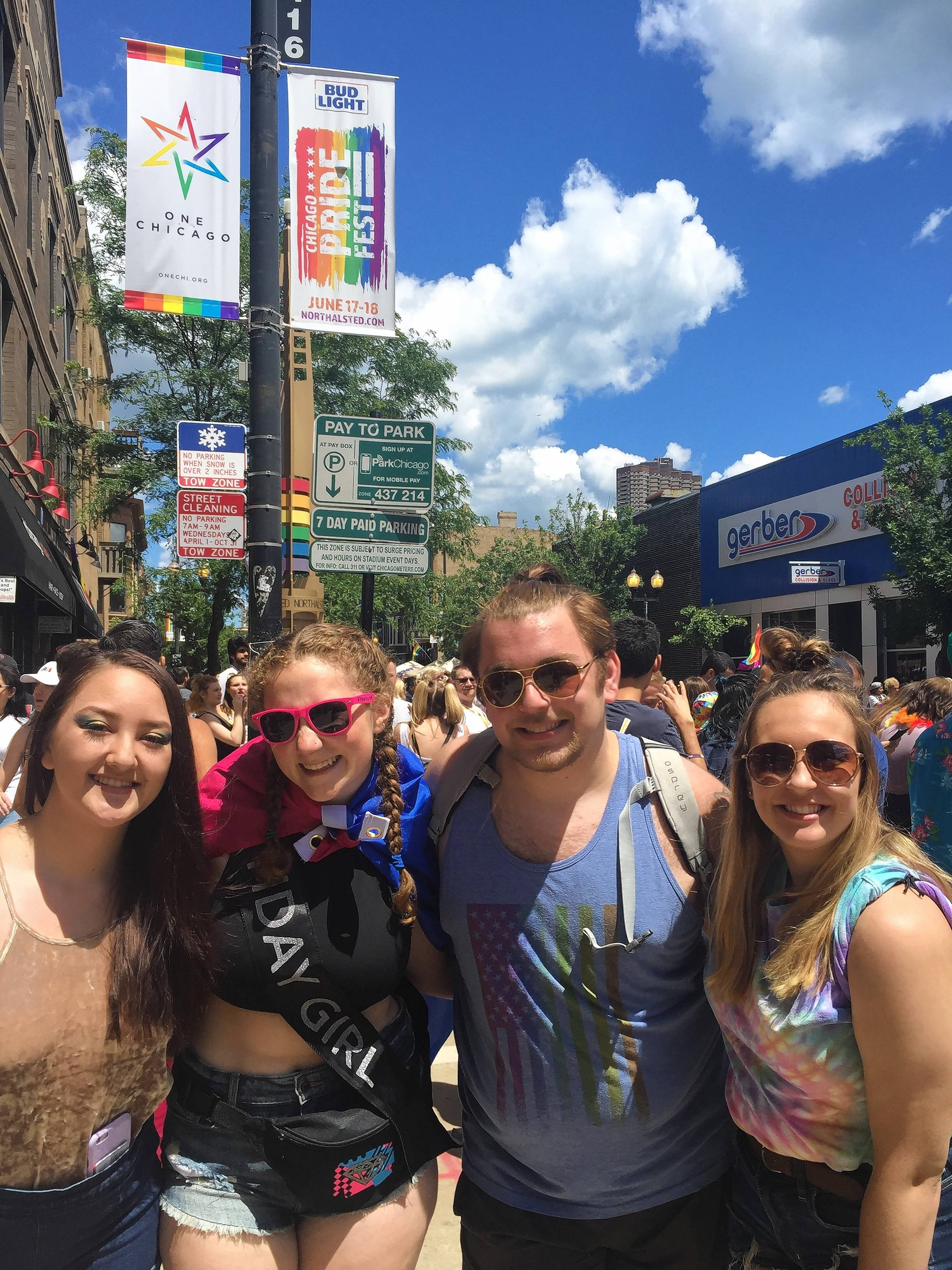 Friends, from left, Alexandra Yamane of Chicago, Liv Richardson of Libertyville, Clay Satherlie of Glenview, and Ashley Wilson of Schaumburg — who met as Illinois State University students — attend the Pride Parade in Chicago on Sunday.