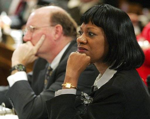 FILE - In this Wednesday, Feb. 9, 2005 file photo, Minority Whip Carolyn Fleming Hugley, D-Columbus, right, and Minority Leader DuBose Porter, D-Dublin, left, attend a meeting at the Capitol in Atlanta. In 2017, Georgia Republicans sought to change the boundaries of several state House districts, including a couple won by Republicans by single-digit margins last November. Some of the proposed shifts sought to move heavily black precincts _ where voters overwhelmingly support Democrats _ from Republican-held districts into ones occupied by Democrats. Although the bill passed the House, it died in the Senate. Hugley criticized it as gerrymandering intended to create safer Republican seats.