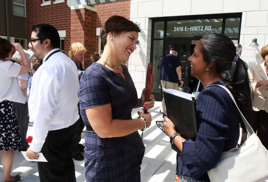 Susan Campbell, director of Cook County Department of Planning and Development, right, talks with Jessica Berzac, president of UP Development, LLC, during Monday's grand opening at PhilHaven in Wheeling. The 50-unit housing development provides apartments for people with disabilities and those previously homeless.