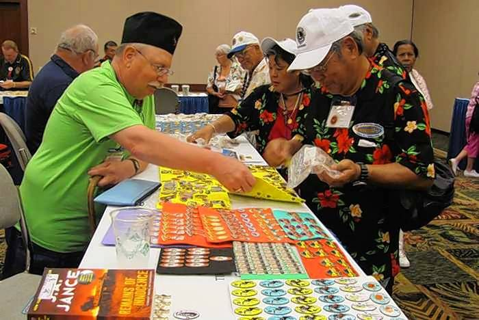 Lions Clubs International Pin Trading Club members swap pins at the 2015 International Convention in Honolulu, Hawaii.