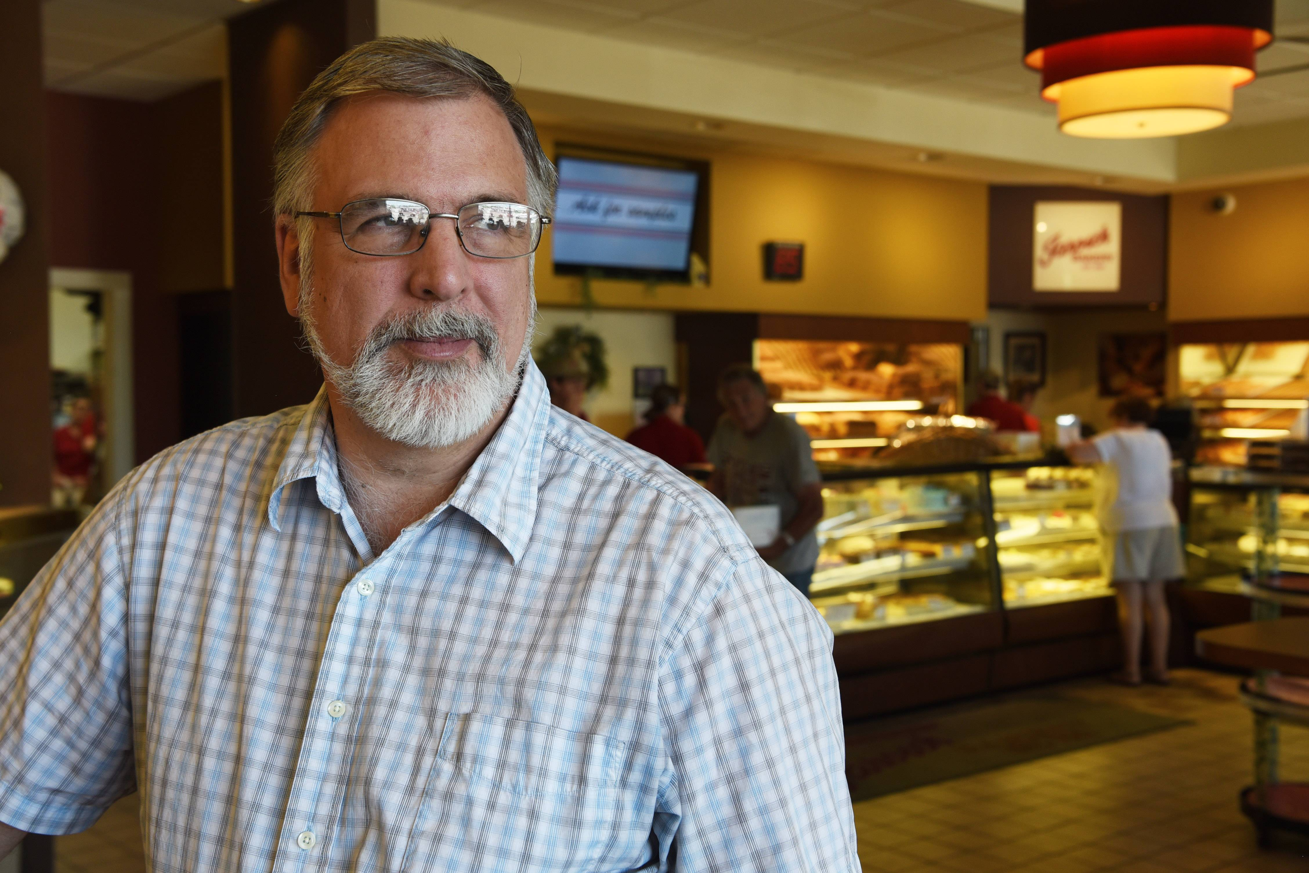Ken Jarosch talks about how a $15 minimum wage could affect his business at Jarosch Bakery in Elk Grove Village.
