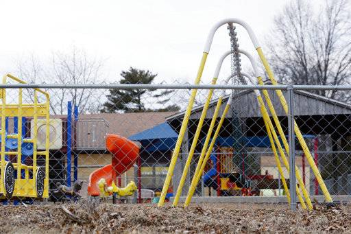 FILE - In this Jan. 26, 2016 file photo, the empty playground at Trinity Lutheran Church in Columbia, Mo. The Supreme Court has ruled that churches have the same right as other charitable groups to seek state money for new playground surfaces and other non-religious needs. The justices on Monday, June 26, 2017, ruled 7-2 in favor of Trinity Lutheran Church of Columbia, Missouri. The church sought a grant to put a soft surface on its preschool playground, but was denied any money even though its application was ranked fifth out of 44 submissions (Annaliese Nurnberg/Missourian via AP, File)