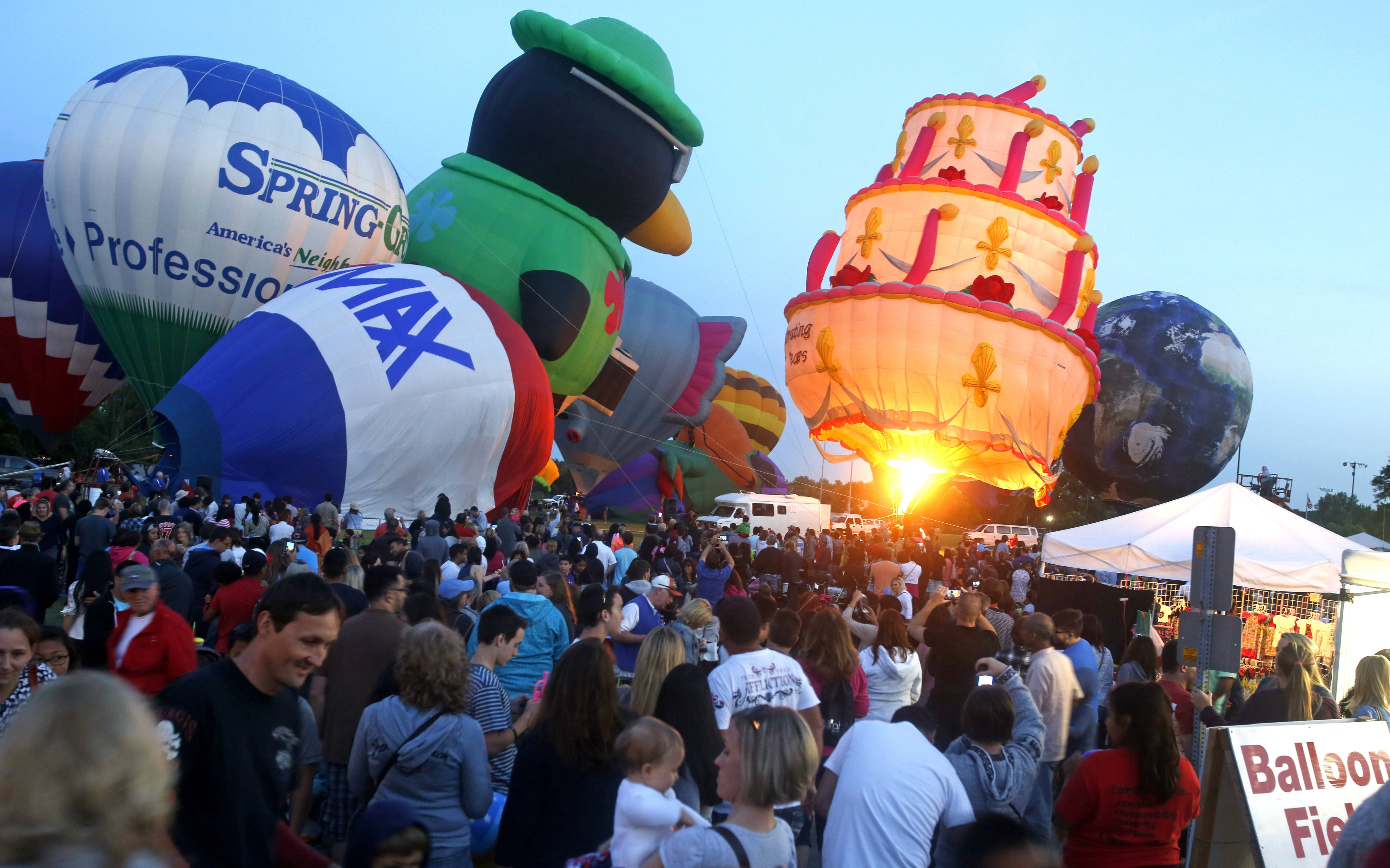 The birthday hot air balloon shows its glow during last year's Eyes to the Skies fest in Lisle.