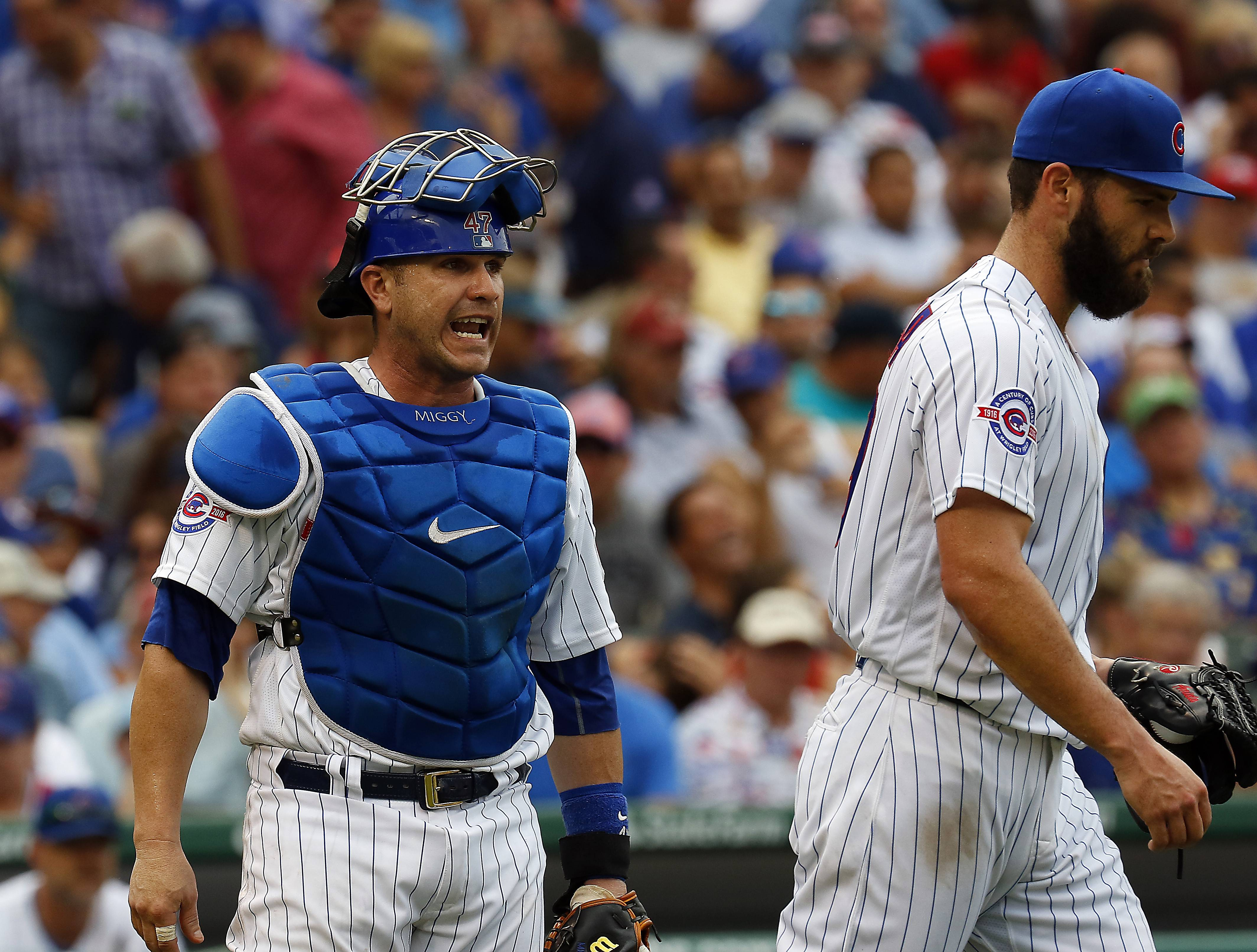 Brian Hill/bhill@dailyherald.com Chicago Cubs catcher Miguel Montero (47) yells some encouragement to Chicago Cubs starting pitcher Jake Arrieta (49) Friday during the Chicago Cubs vs. St. Louis Cardinals at Wrigley Field.