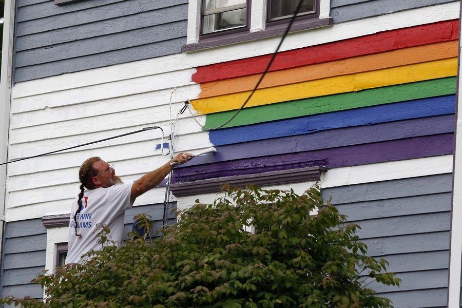 Man paints over rainbow stripe on Elgin house