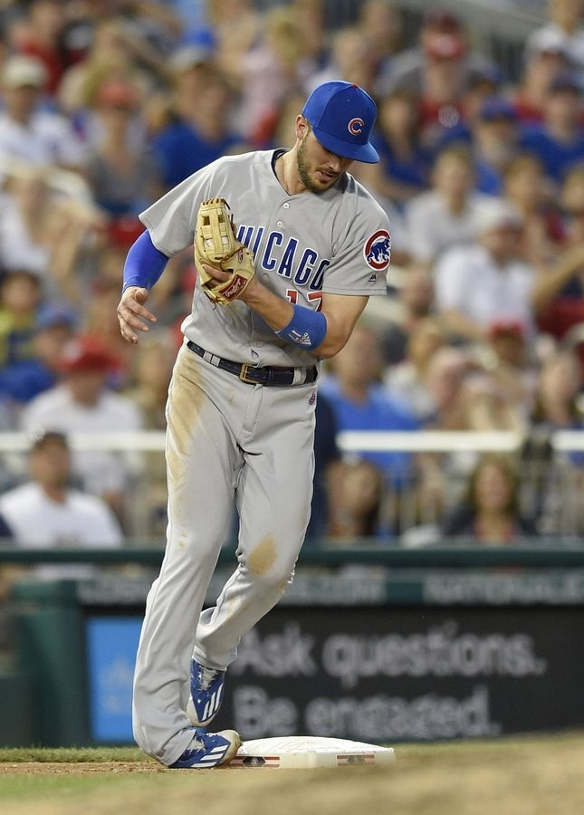Chicago Cubs third baseman Kris Bryant rolls his foot on the bag after making a catch on a pop-up by Washington Nationals' Matt Wieters during the fifth inning of a baseball game, Wednesday, June 28, 2017, in Washington. Bryant left the game with an injury on the play.