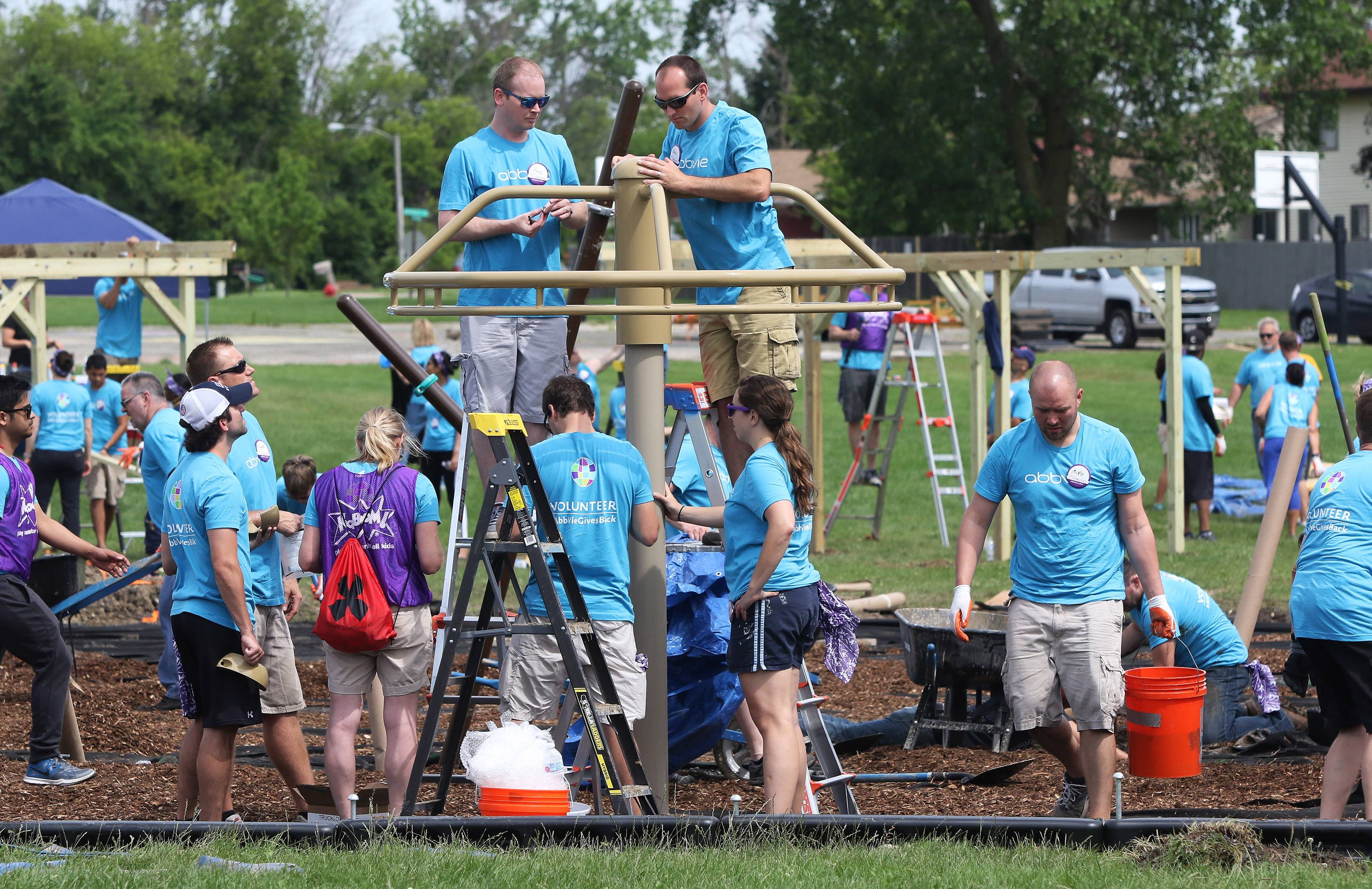 More than 400 volunteers built a new playground Thursday at A.J. Katzenmaier Academy in North Chicago. Employees from AbbVie, sailors from Naval Station Great Lakes and local community members joined KaBOOM! to work on the project.