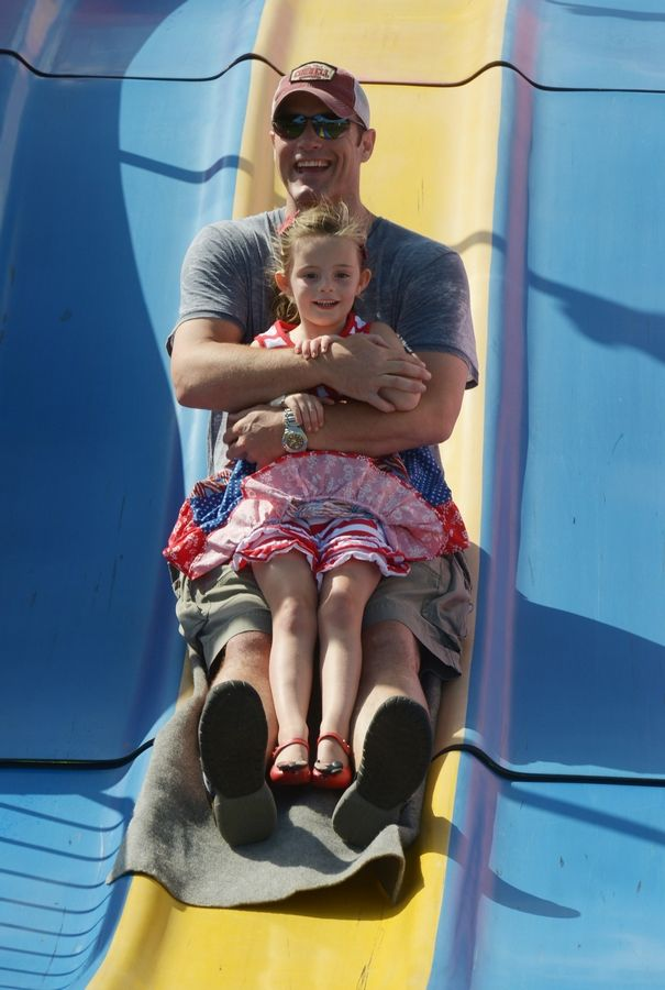 Kensington Kiely, 4, of Grayslake, and her dad, Kevin, descend the Fun Slide together during the Grayslake Family Picnic at Central Park.