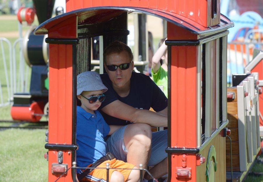 Max Koolman, 4, of Grayslake, and his dad, Hannes, ride in the caboose of the train during the Grayslake Family Picnic at Central Park.
