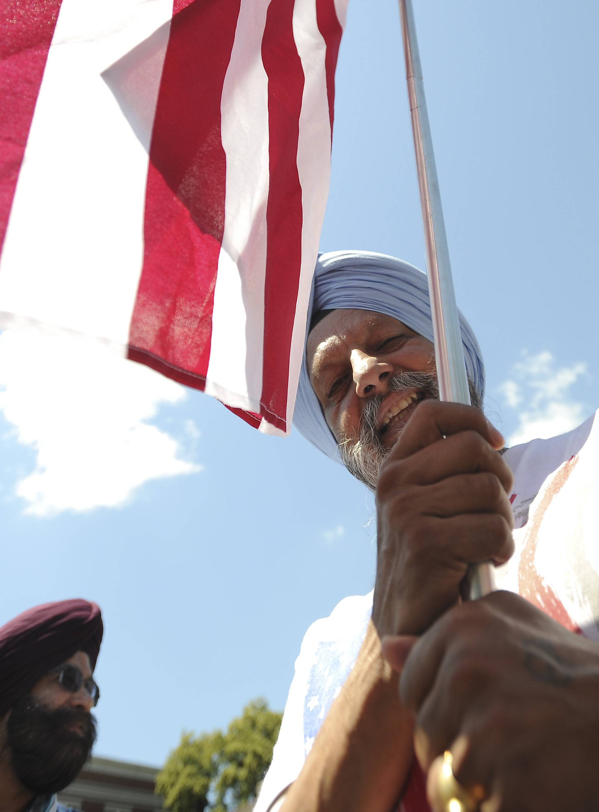 Thakar Basati of Palatine walks at Palatine's annual Hometown Fest Fourth of July parade on Saturday.