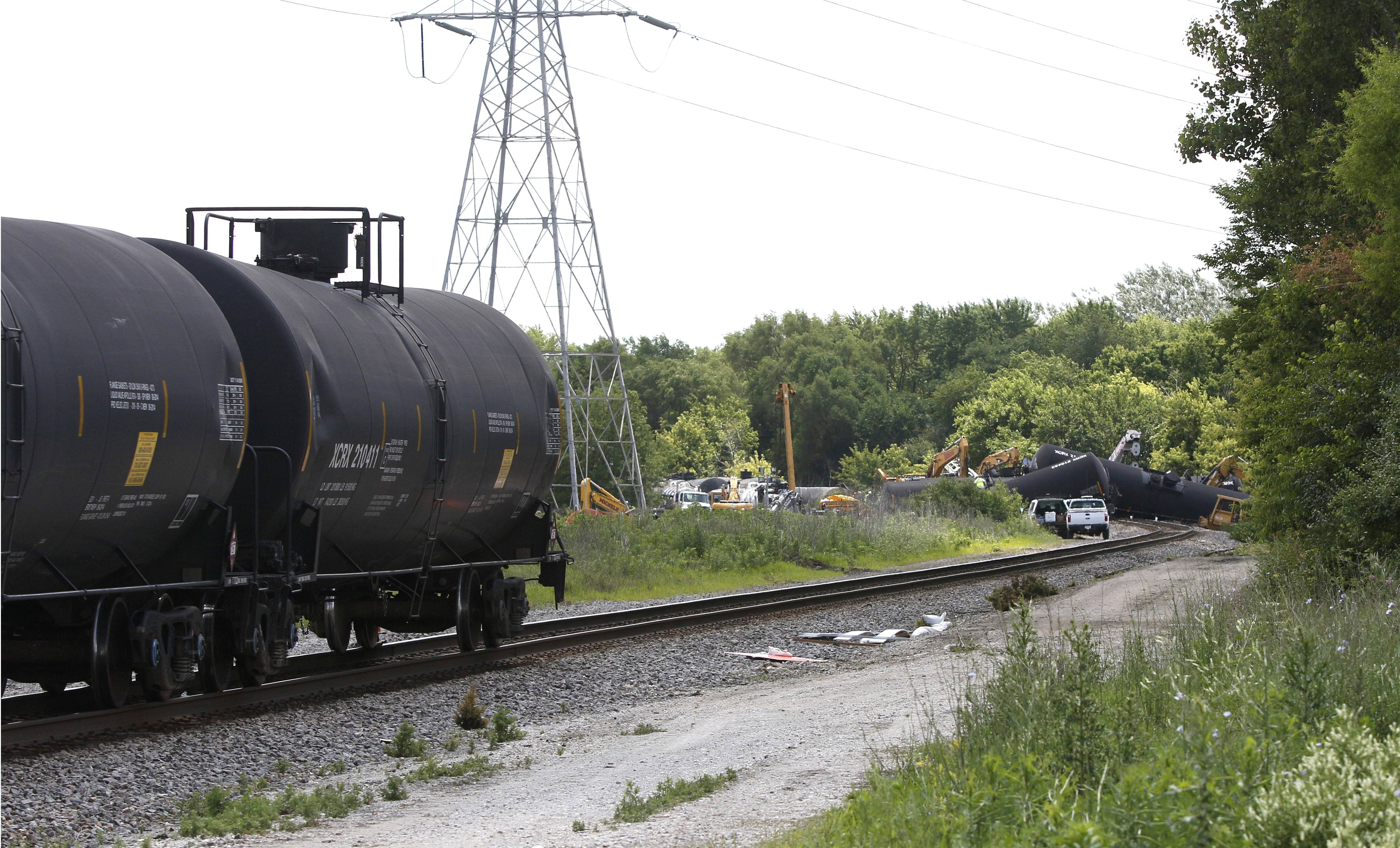 Several Canadian National Railroad tanker cars remain upright Saturday at 143rd Street behind the roughly 20 that derailed Friday evening in Plainfield.