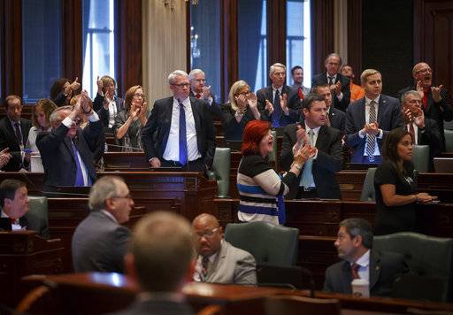 """I want this done today,"" says Illinois House Minority Leader Jim Durkin, R-Western Springs, as the Republican side of the aisle erupts in applause on the House floor after Illinois Speaker of the House Michael Madigan, D-Chicago, says the House will be in session Sunday, during the overtime session at the Illinois State Capitol, Saturday, July 1, 2017, in Springfield, Ill. Madigan said there would be a vote on the House floor Sunday on a plan ""modeled on the bill supported"" by Republican Gov. Bruce Rauner. (Justin L. Fowler/The State Journal-Register via AP)"