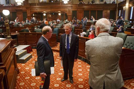 "Illinois Speaker of the House Michael Madigan, D-Chicago, walks off the Illinois House floor during the overtime session at the Illinois State Capitol, Saturday, July 1, 2017, in Springfield, Ill. Madigan said there would be a vote on the House floor Sunday on a plan ""modeled on the bill supported"" by Republican Gov. Bruce Rauner. (Justin L. Fowler/The State Journal-Register via AP)"