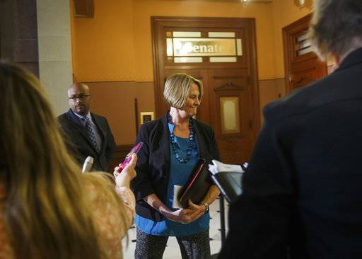 Illinois Senate Minority Leader Christine Radogno, R-Lemont, steps away after talking with the media on her last day before stepping down during the overtime session at the Illinois State Capitol, Saturday, July 1, 2017, in Springfield, Ill. (Justin L. Fowler/The State Journal-Register via AP)