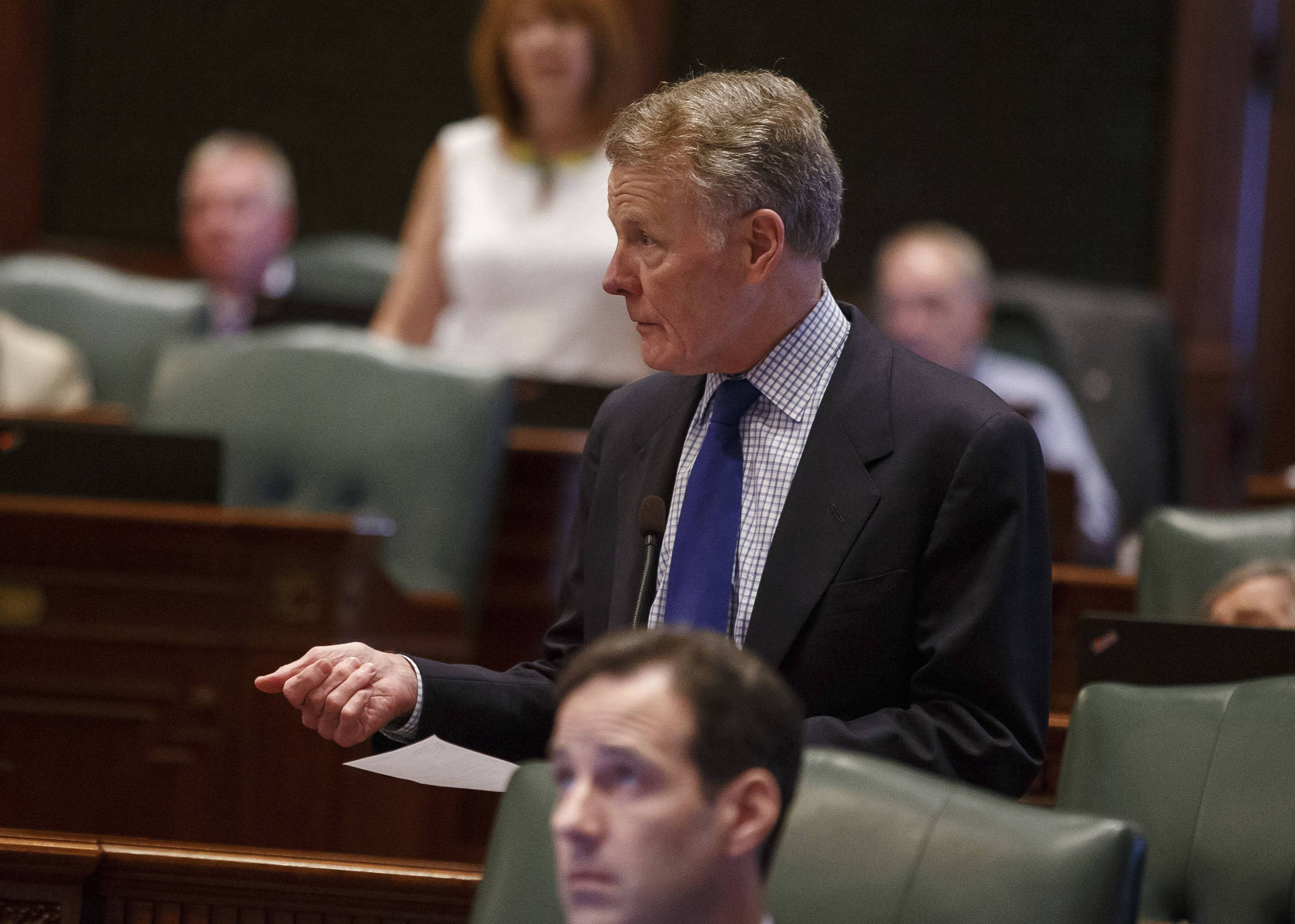 Illinois speaker of the House Michael Madigan House floor at the State Capitol on Saturday. On Sunday, the House passed a bill that will increase the state's personal income tax rate by 32 percent.