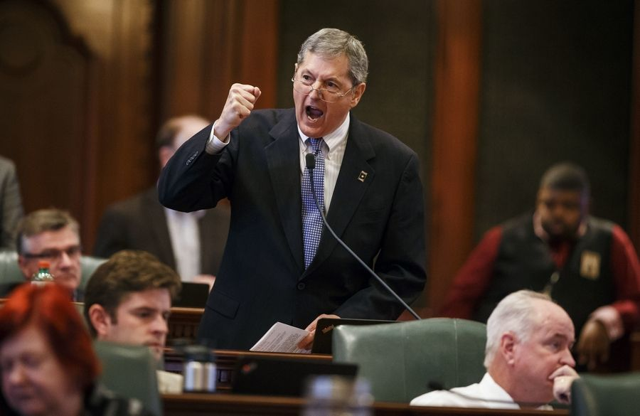 Republican State Rep. David Harris of Arlington Heights makes a point during the overtime session at the state Capitol Sunday. The House, with Harris' and other suburban lawmakers' help, approved an income tax increase as part of a plan to end the nation's longest budget standoff.