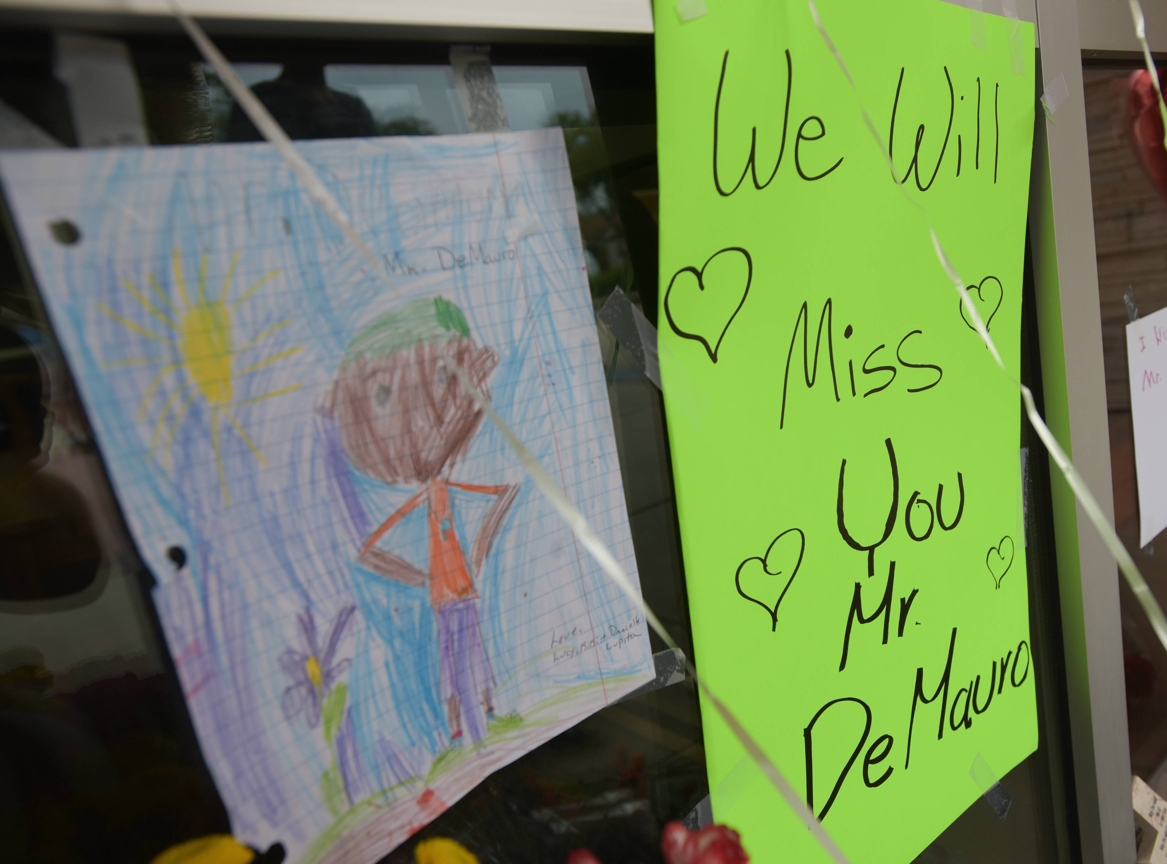 Flowers and notes were left by the door at Tioga Elementary School in Bensenville for teacher Thomas DeMauro, who was killed Saturday in a plane crash in northern Wisconsin.