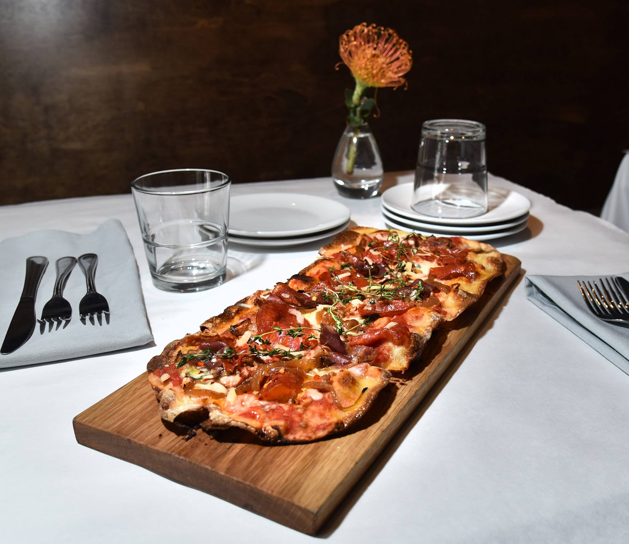The Butcher Flatbread comes topped with a variety of meats at Livia Italian Eatery in Geneva.