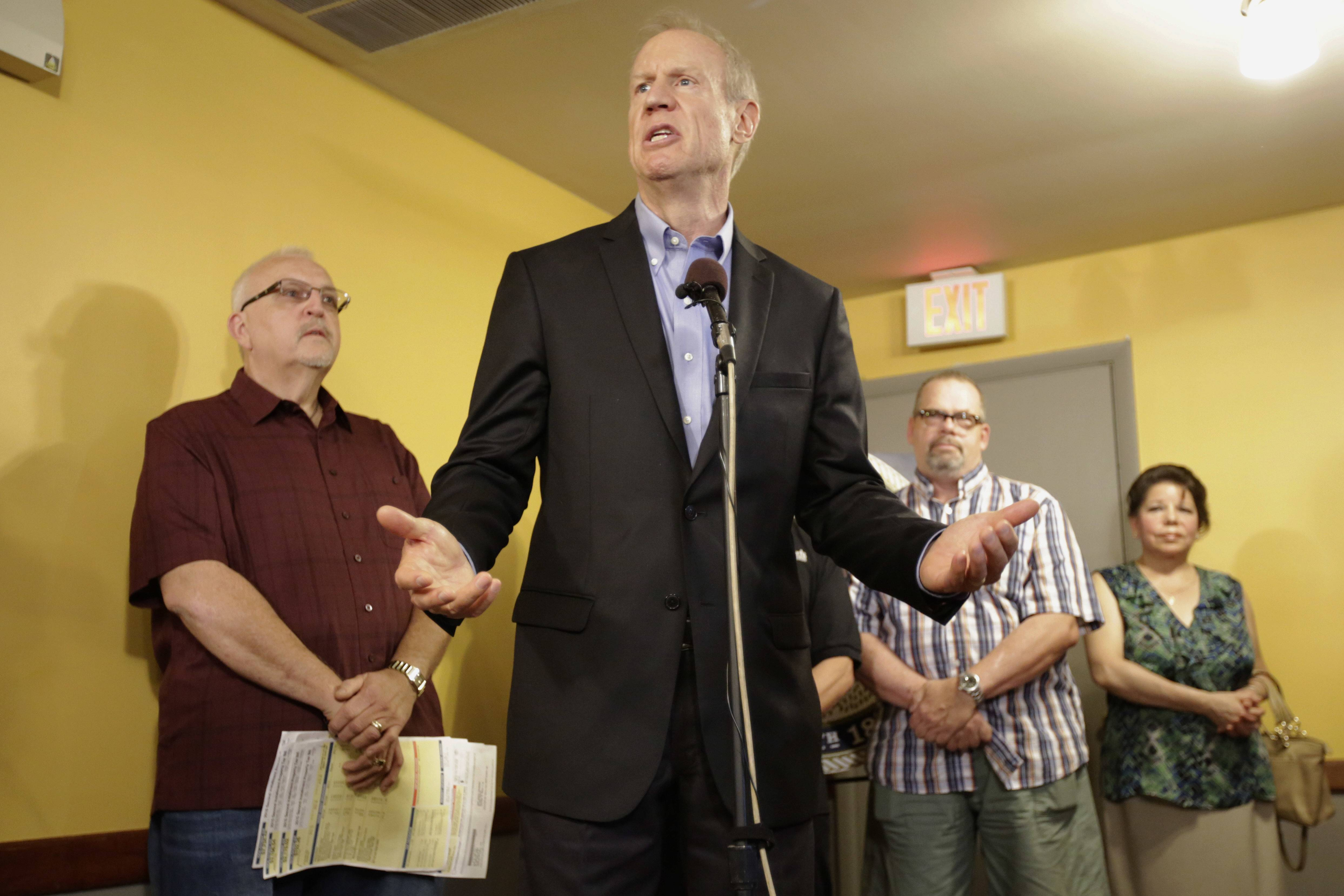 Illinois Gov. Bruce Rauner, speaking at a news conference Wednesday in Chicago, will find out today whether the state House will override his veto of an income tax increase.