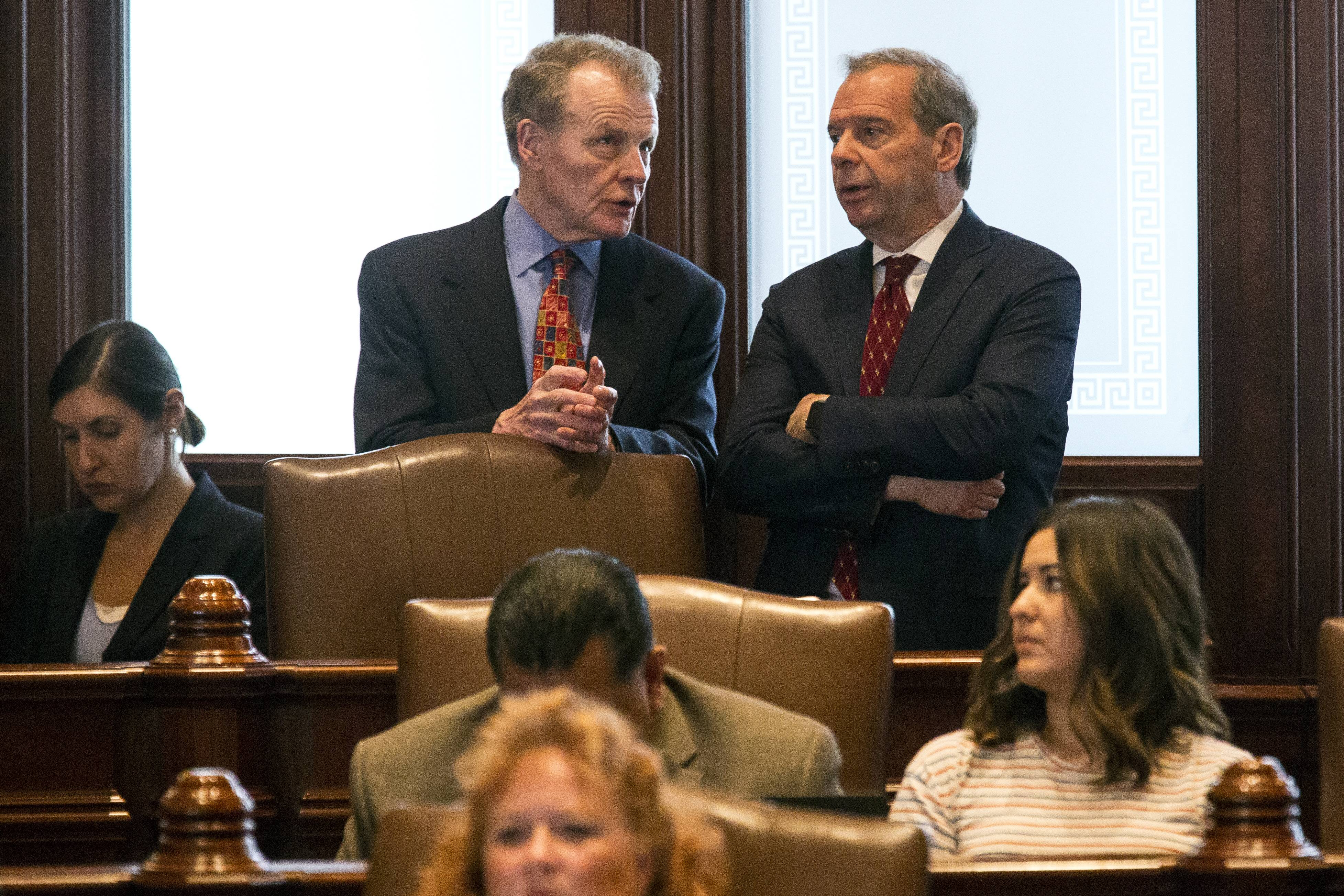 House Speaker Michael Madigan, a Chicago Democrat, left, and Senate President John Cullerton, a Chicago Democrat, talk on the Senate floor Tuesday at the Capitol in Springfield.