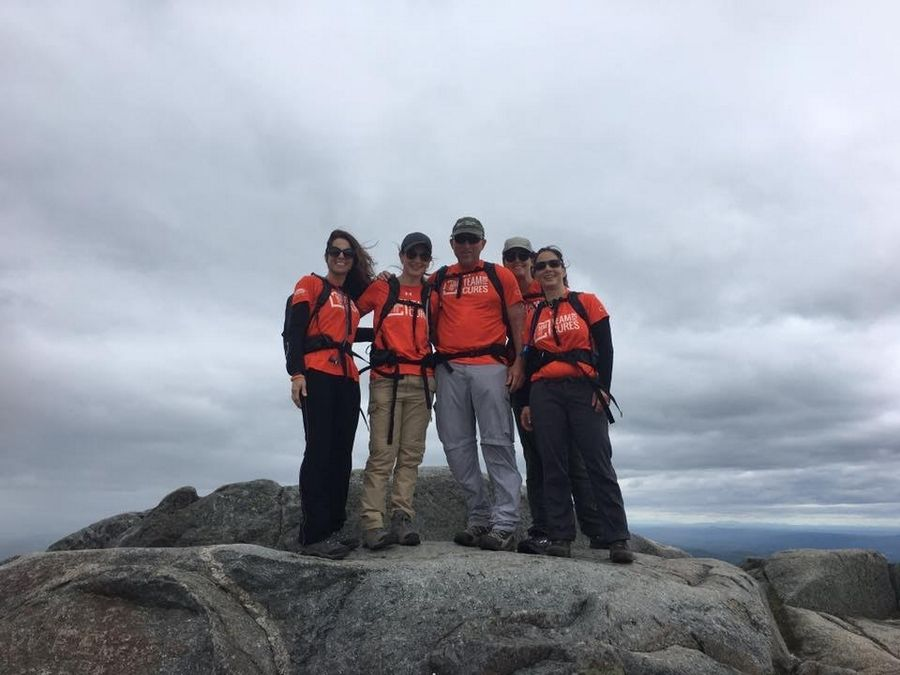 Jean Wescher, second from left, and other team members finish a practice climb in New Hampshire ahead of a fundraising climb of Mt. Fuji in Japan.