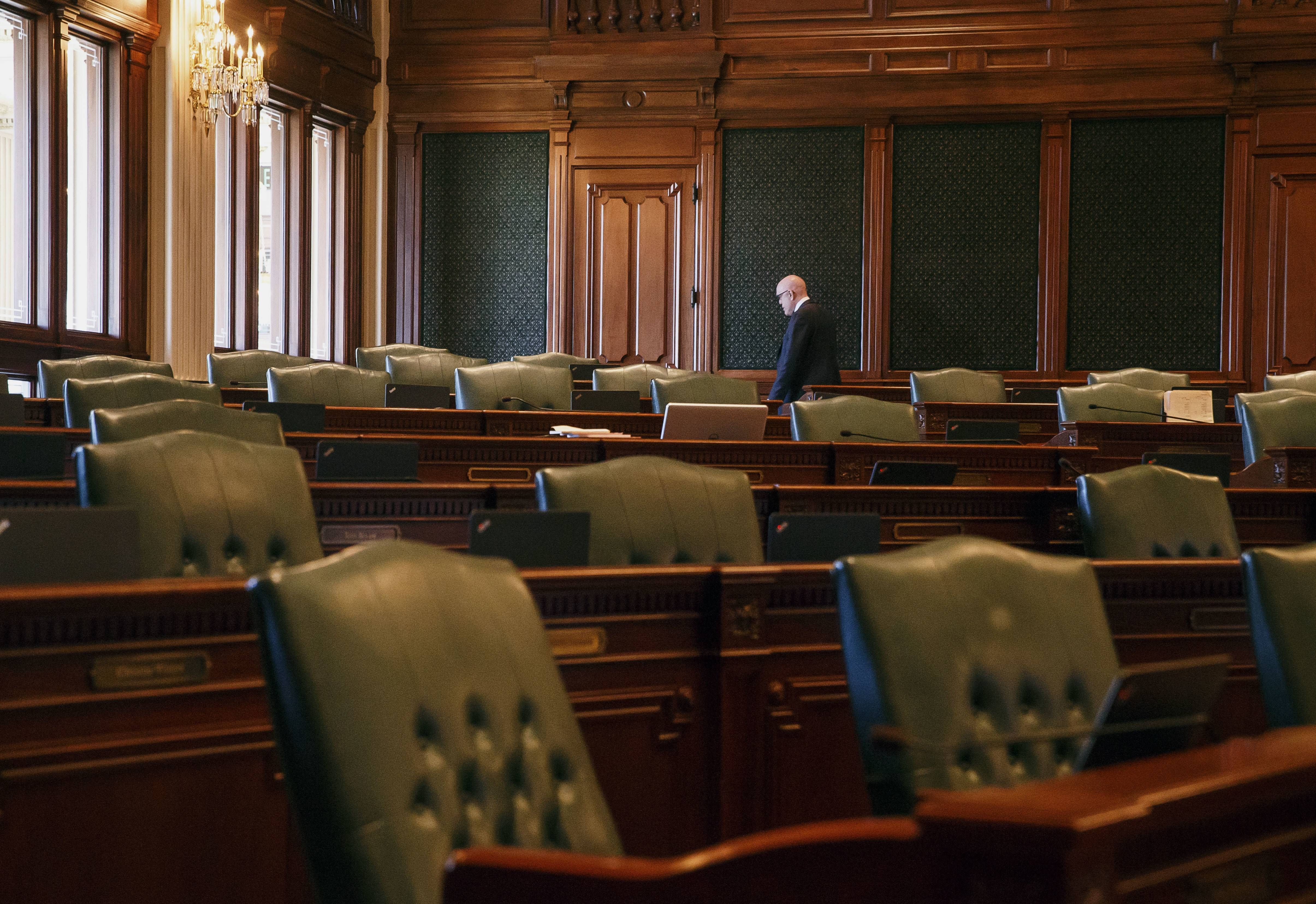 State Rep. Greg Harris, a Chicago Democrat, walks through the empty floor of the Illinois House before the vote on an income tax increase bill Sunday.
