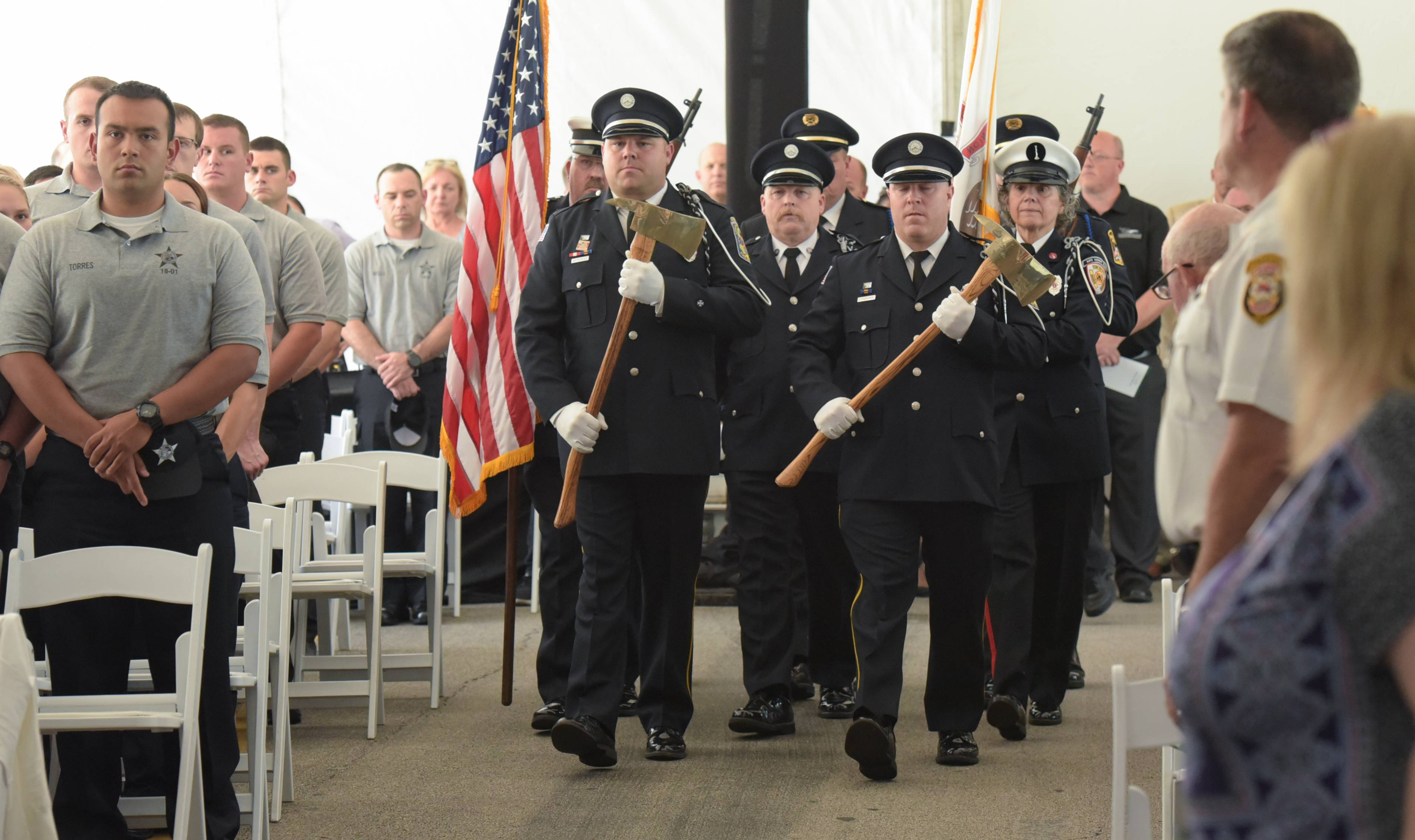 Members of the Lisle-Woodridge Fire District, Darien-Woodridge Fire District and Woodridge Police Department present the colors during the ceremony Thursday.
