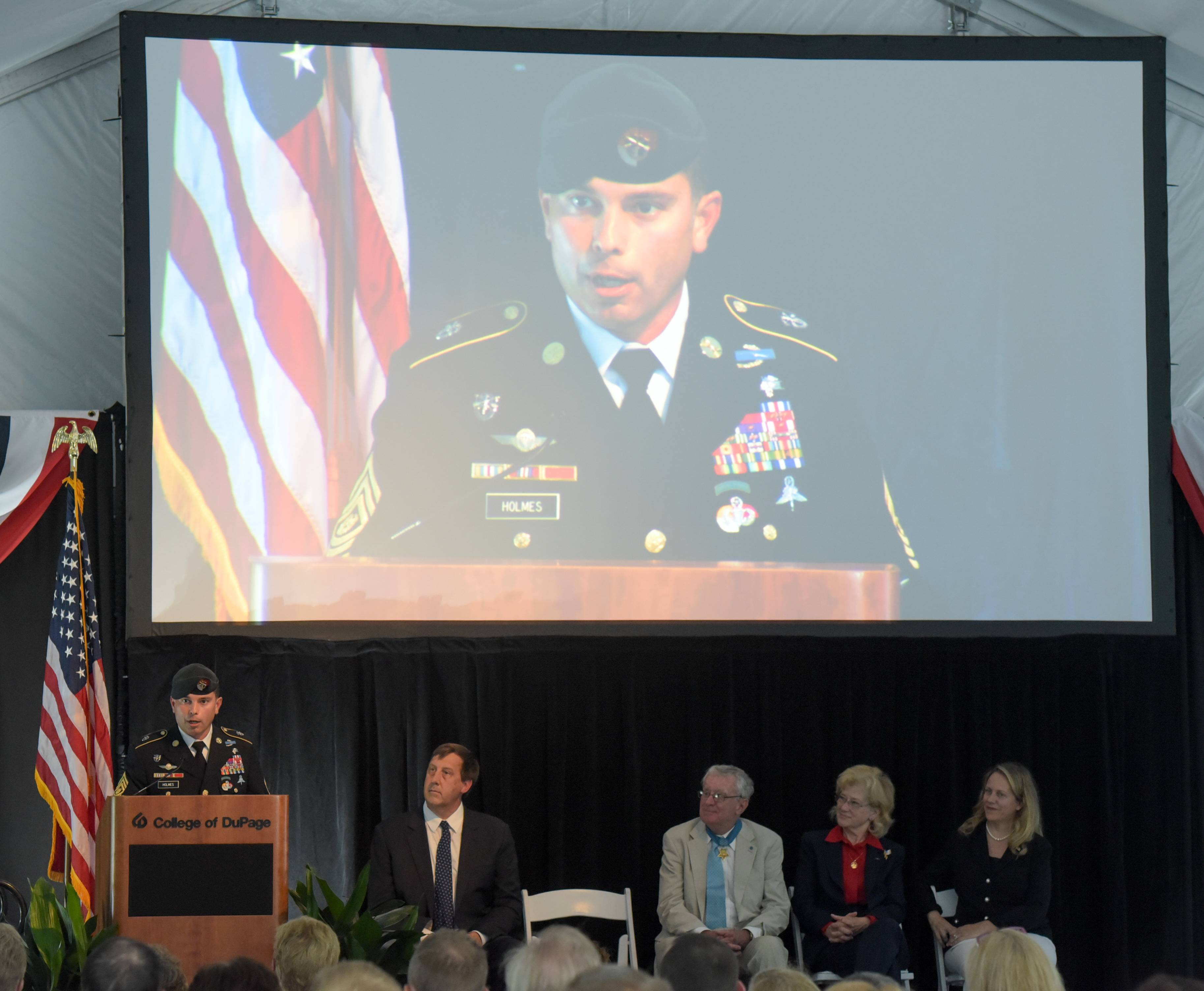 Command Sgt. Major Bruce Holmes of the U.S. Army 3rd Special Forces Group addresses the crowd at the College of DuPage.
