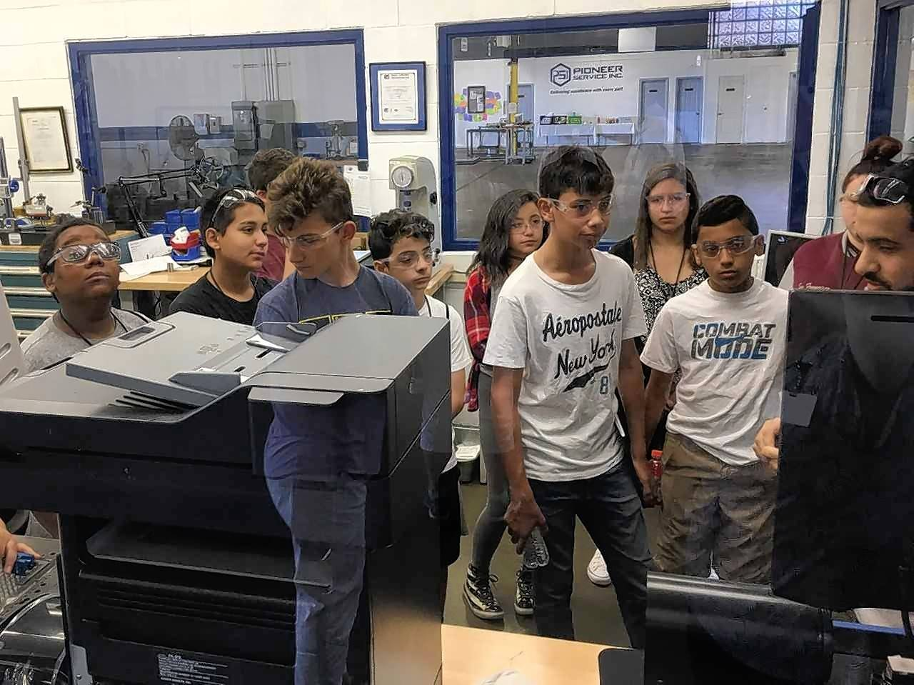 Students from Indian Trail Junior High School in Addison are introduced to a variety of machines and tools that are used to guarantee quality control at Pioneer Service Inc., a local manufacturing company.