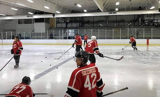 The Brook Electrical Bolts team hits the ice at the Glacier Ice Arena in Vernon Hills during the recent Pucks for Autism tournament. The event raised a total of $32,706 to help children and young adults with autism.