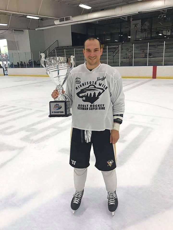 Mark Seske poses with the cup after winning the B2 Championship with his team: Friends with Penalties. Seske helped raise over $1,000 for the Pucks for Autism tournament.