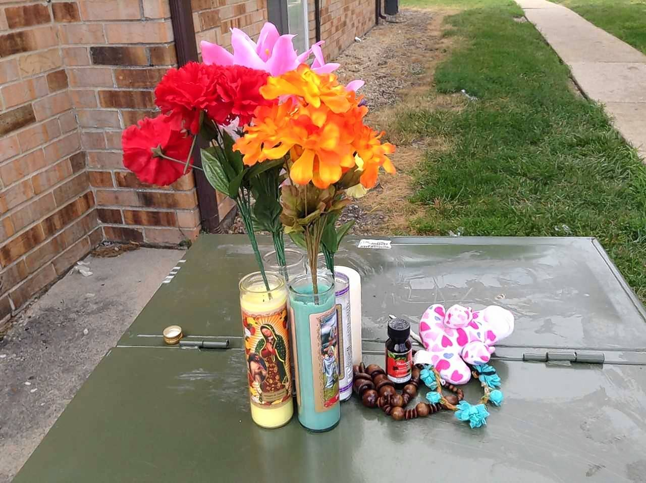 Flowers and candles were placed outside a Des Plaines-area apartment building Sunday, where a 17-year-old Glenview girl was fatally shot early Saturday. The Cook County Sheriff's Office is investigating the shooting.