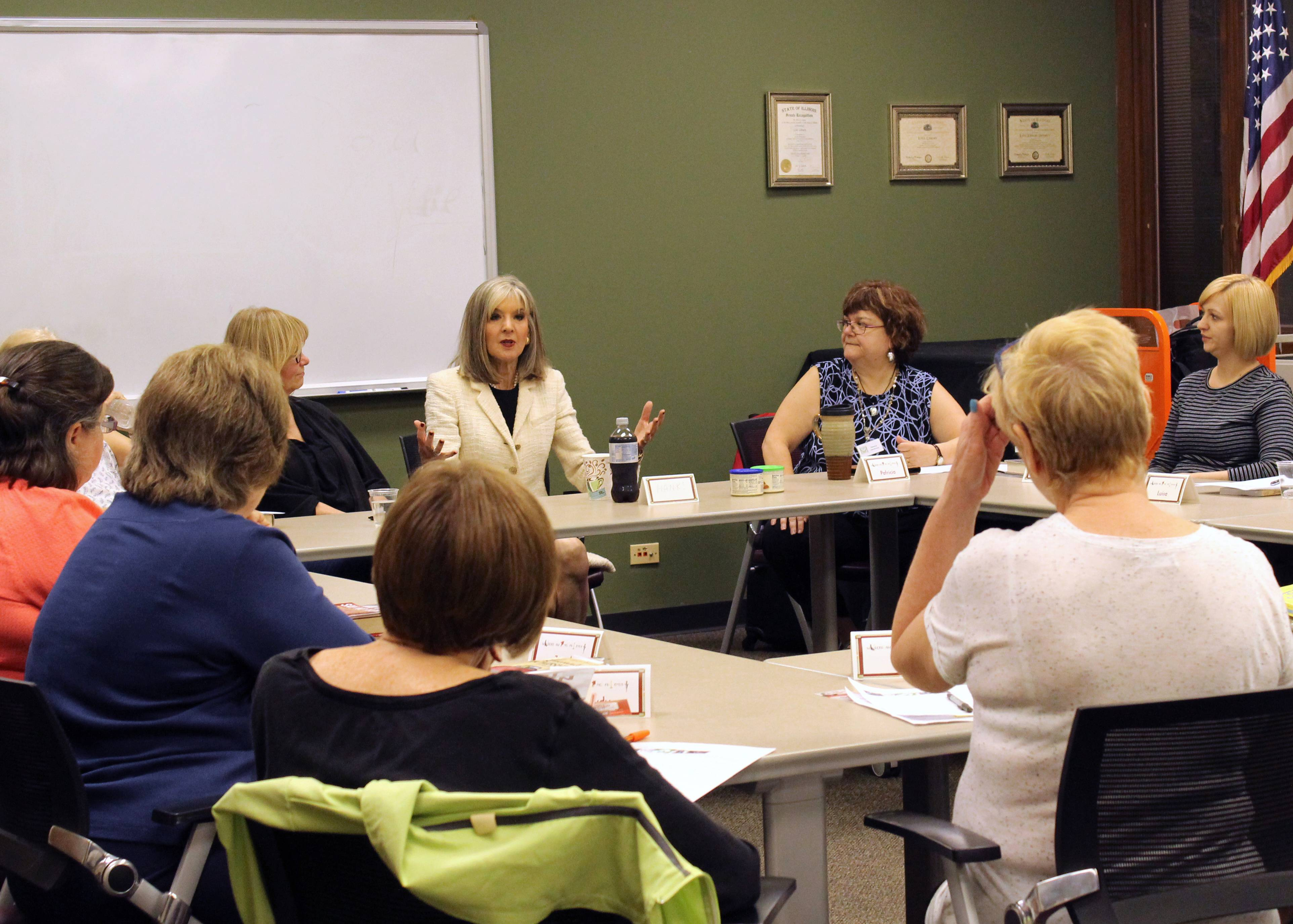 Hank Phillippi Ryan (center) answers questions from attendees and members of Lisle Library's Murder Among Friends mystery book group.Taylor Habal