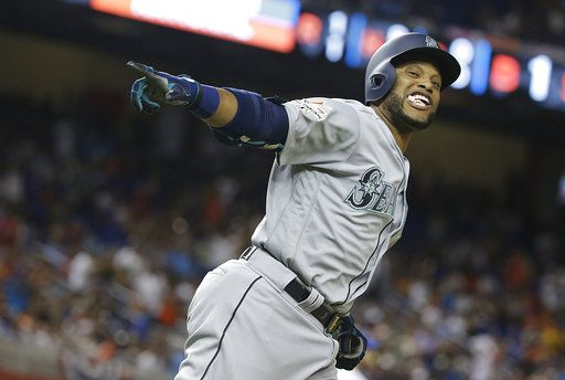 d37a4cee685 American League's Seattle Mariners Robinson Cano (22), rounds the bases  after hitting a