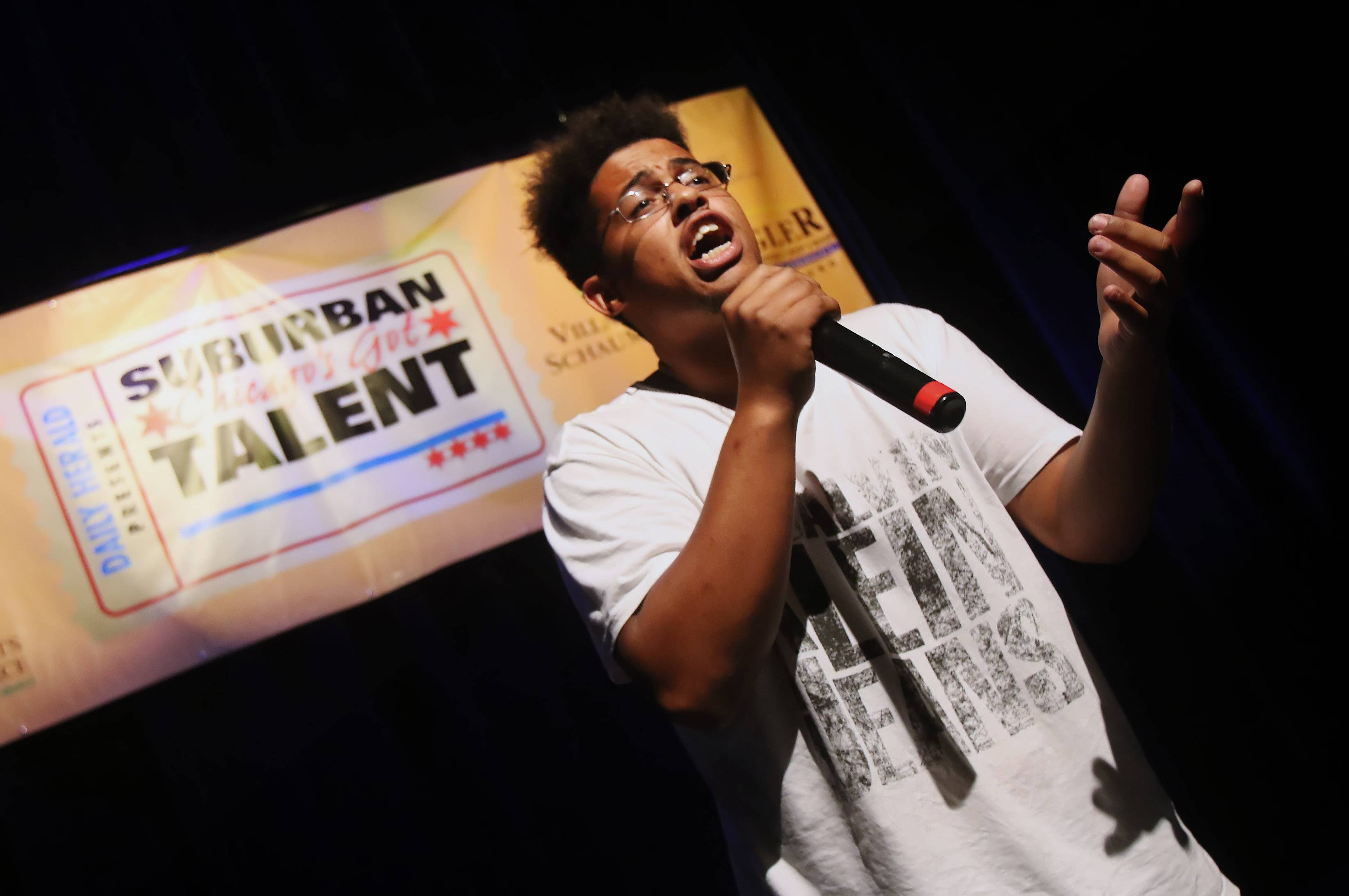 Gilbert R. Boucher II/gboucher@dailyherald.comLucky of Arlington Heights sings during Suburban Chicago's Got Talent competition on Sunday at the Prairie Center for the Arts in Schaumburg. The top 20 finalists performed in hopes of winning a grand prize that includes the opportunity to open for a national act at the Arcada Theatre in St. Charles.