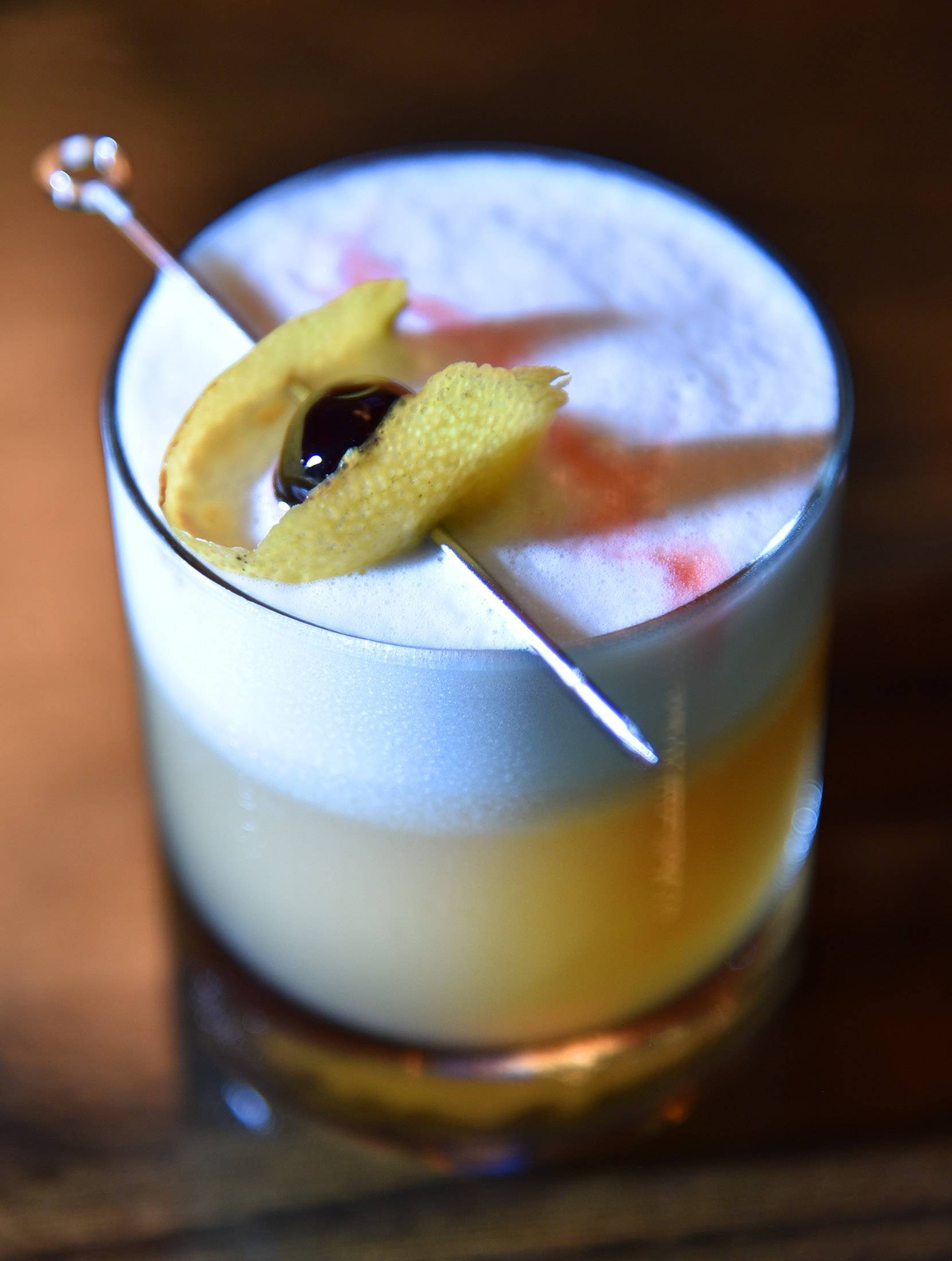 The Common Ground, a foamy drink made with amaretto, bourbon, lemon, sweet meringue and cherry, is on the Now Shaken menu at M Supper Club.