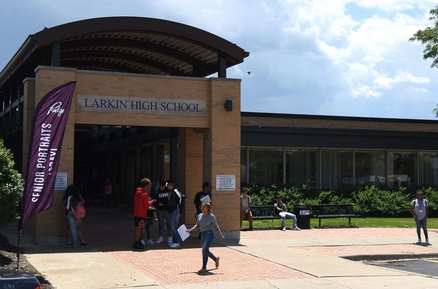 Students leave summer school at Larkin High School in Elgin. While the first state budget has passed since 2015, schools won't get money if an education funding bill isn't signed into law.