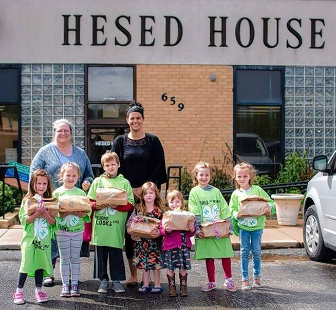 Helping Hearts 4-H Cloverbuds of Kane County brings 20 bags to Hesed House in Aurora.