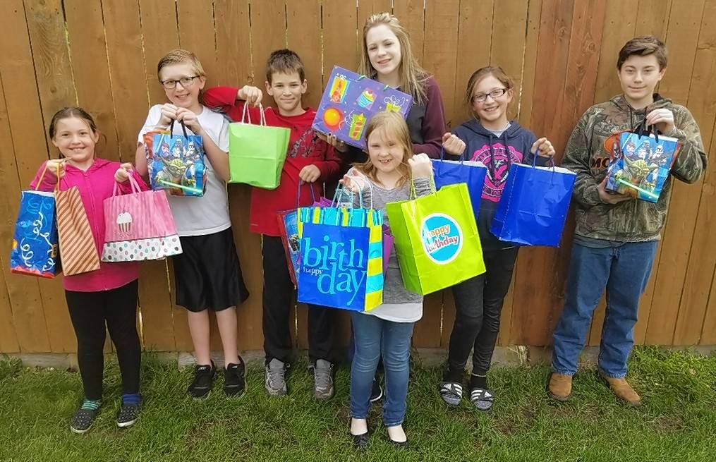 Boots, Blue Jeans and Bows 4-H Club of Kendall County donates birthday bags to The Store at Harvest Chapel in Sandwich.