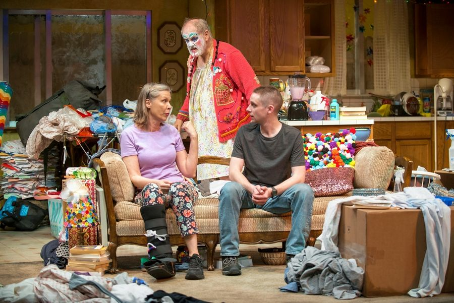 "Paige (Amy Morton) explains why her incapacitated husband, Arnold (Francis Guinan), is wearing makeup and a women's housecoat to their son, Isaac (Ty Olwin), in ""Hir."" Taylor Mac's comic-drama runs through Aug. 20 at Chicago's Steppenwolf Theatre."