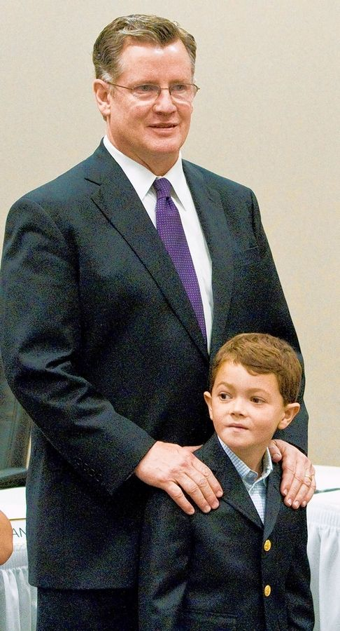 Bill Cadigan with his son Billy at the Illinois State Board of Elections headquarters in Springfield.