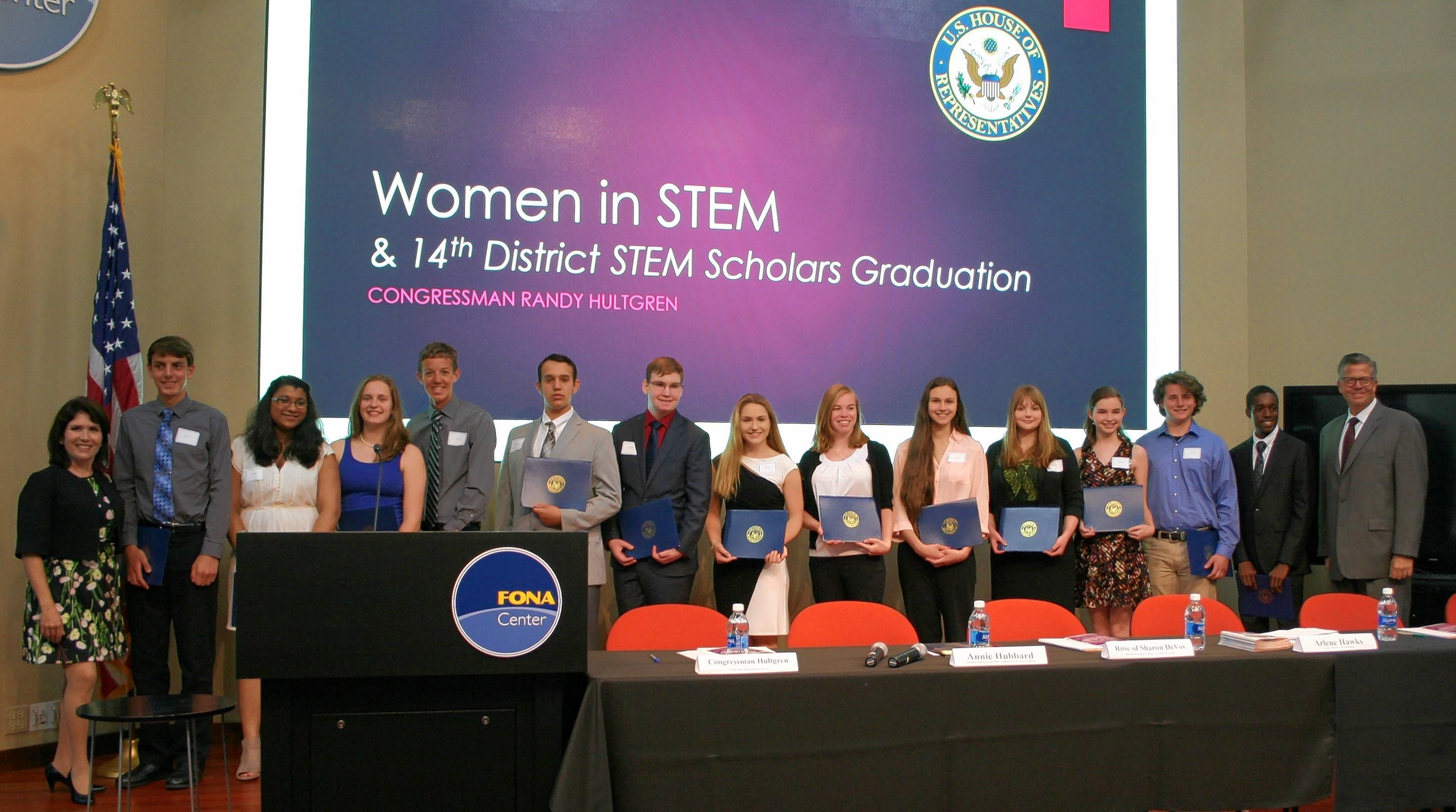 The inaugural class of STEM Scholars joins U.S. Rep. Randy Hultgren, right, for a photo during the graduation event.
