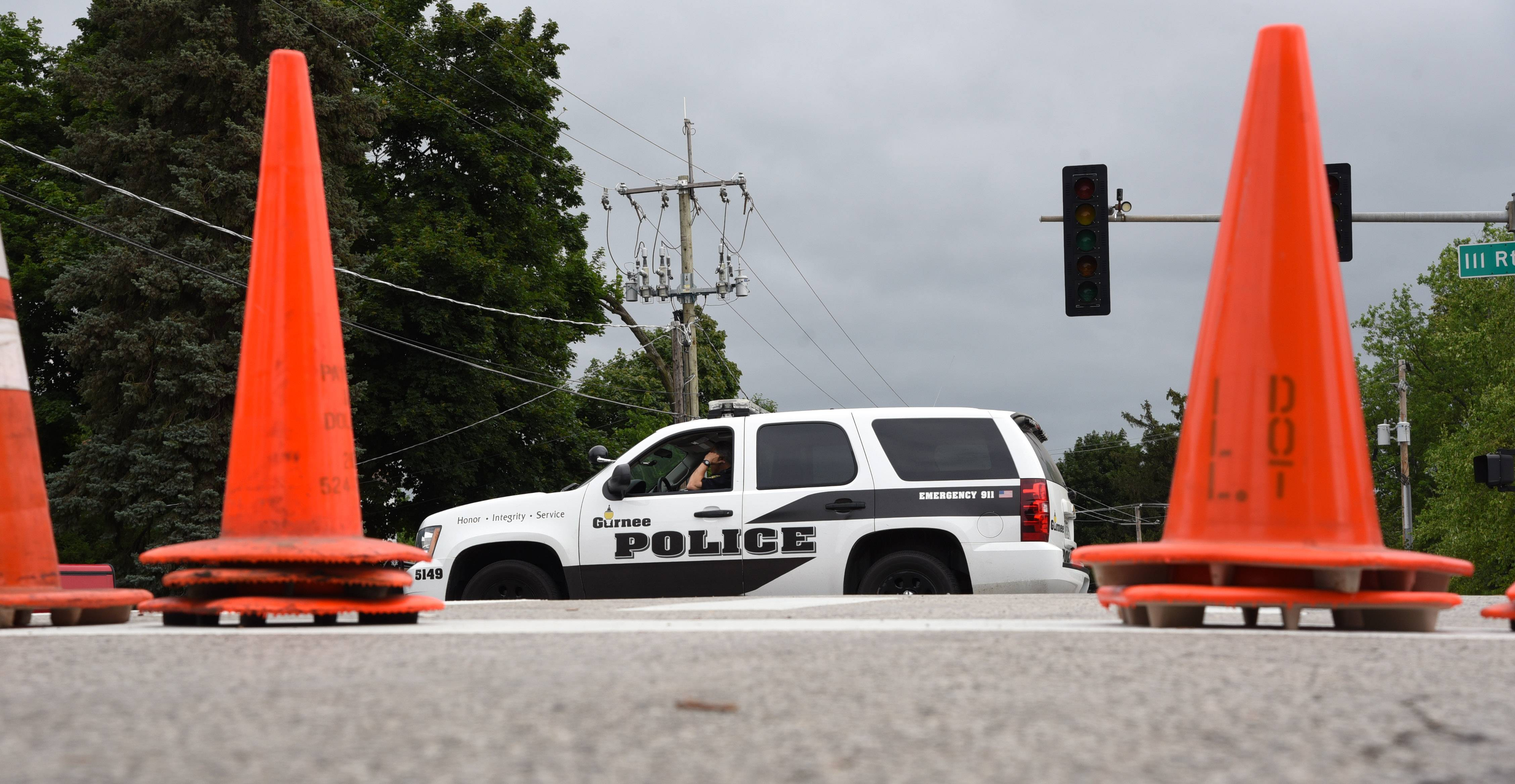Grand Avenue in Gurnee is closed due to floodwaters from the Des Plaines River on Friday. Gurnee police watch over the Grand Avenue and O'Plaine Road intersection.