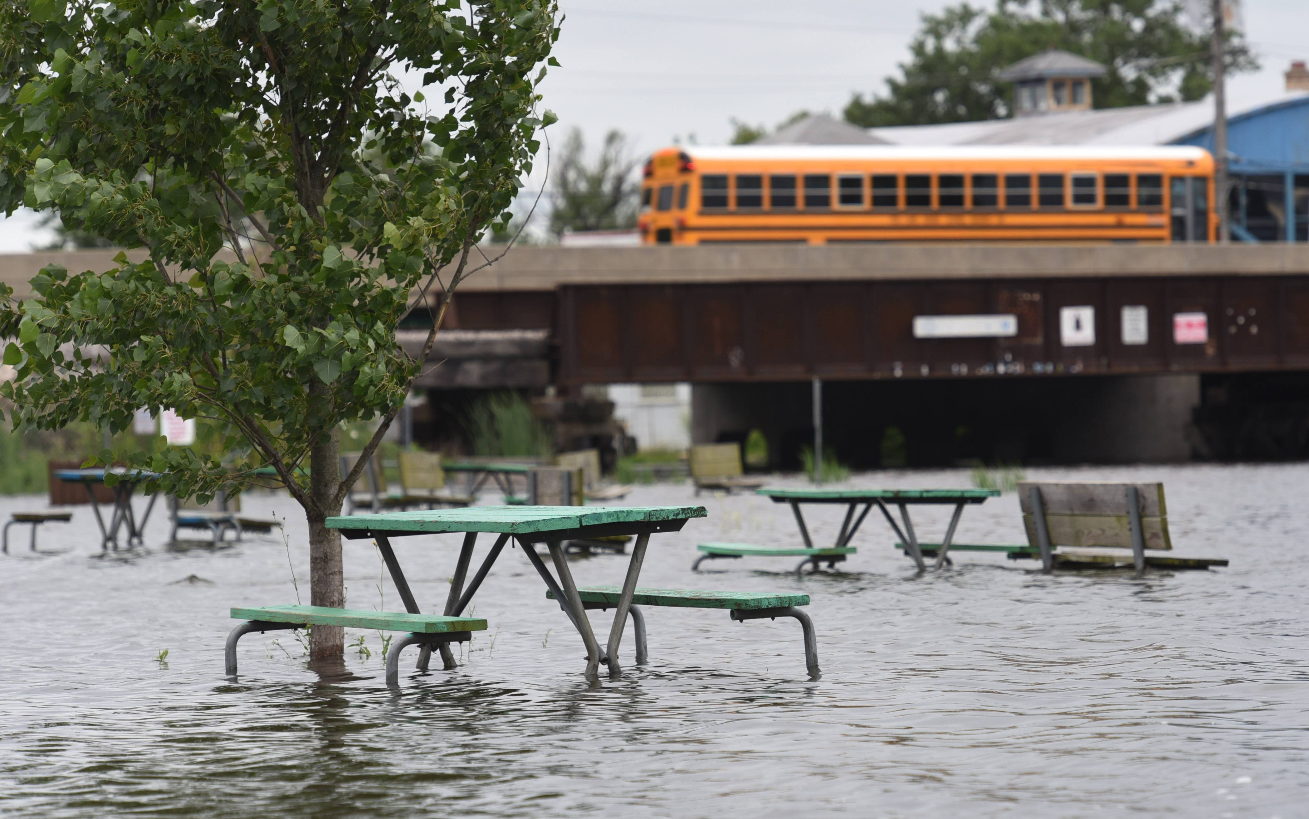 Rising water is affecting Lakefront Park in Fox Lake Friday.