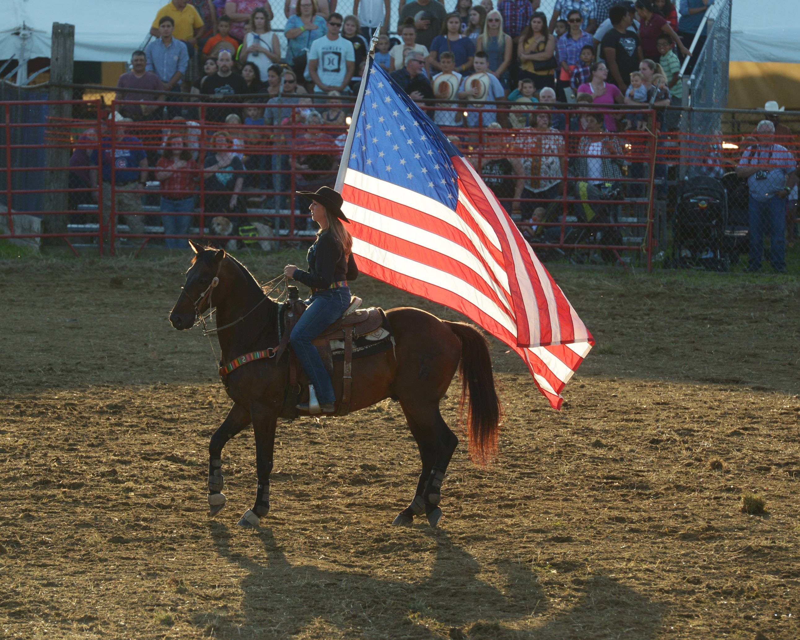 Cobie Norris carries the flag during the 54th annual IPRA Championship rodeo Saturday in Wauconda.