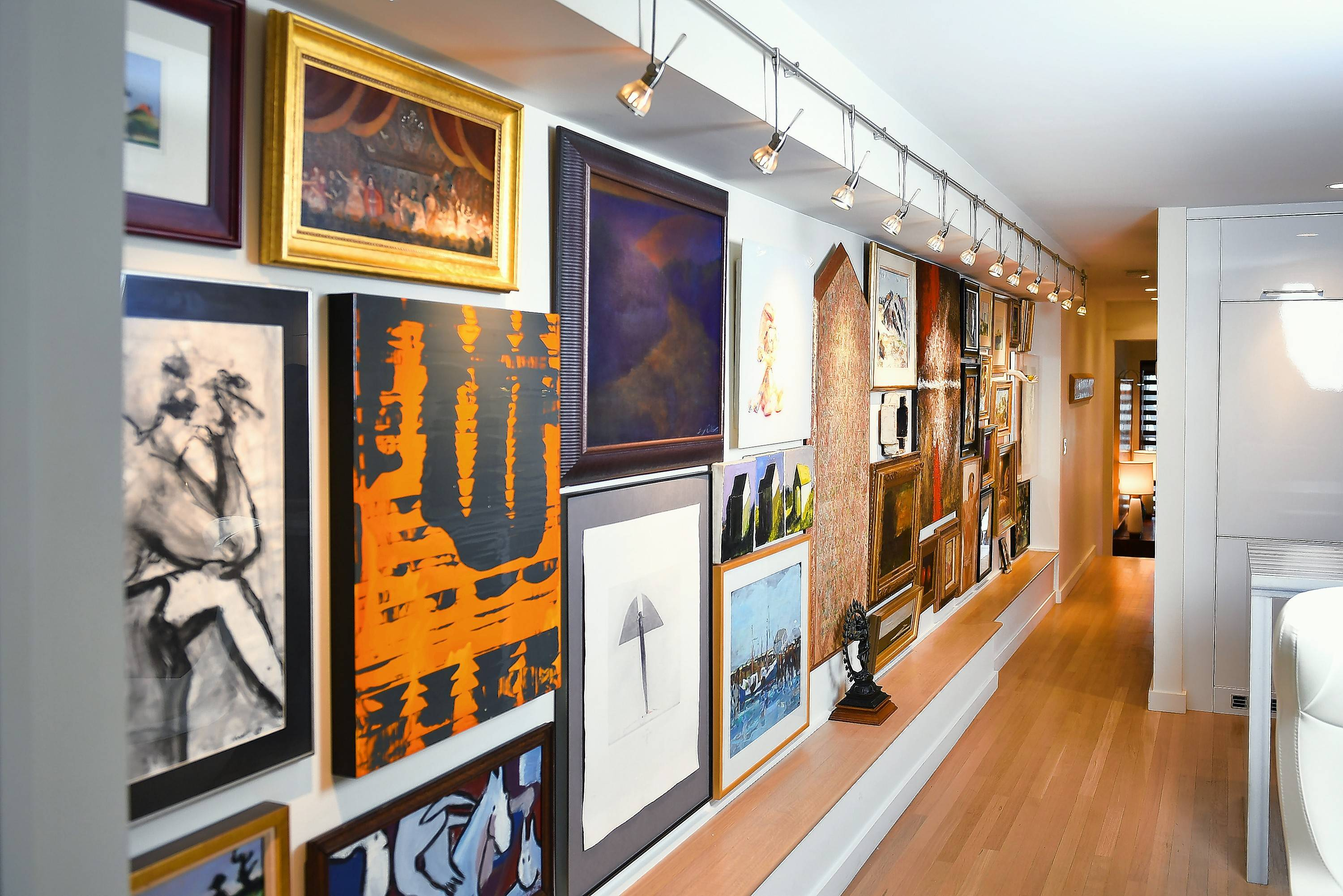 A 25-foot gallery wall is the focal point of George Dant's 725-square-foot Washington, D.C., apartment and features a large portion of his art collection.